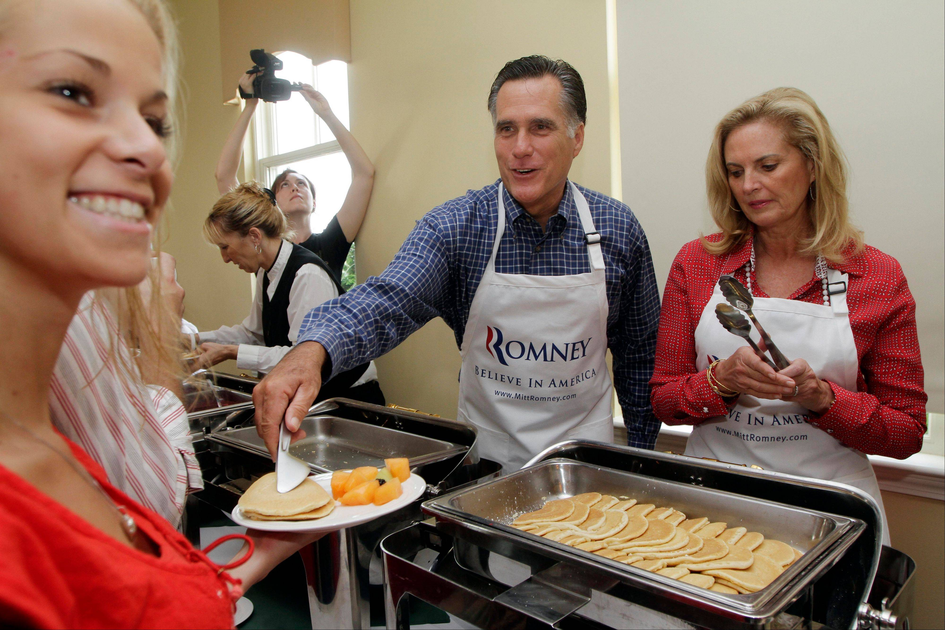 Republican presidential candidate, former Massachusetts Gov. Mitt Romney and his wife Ann served pancakes during a Labor Day pancake breakfast Monday in Manchester, N.H. On Tuesday he served up his a jobs creation proposal.