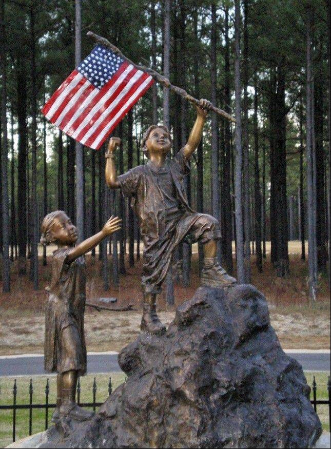 The bronze sculpture in Reed-Keppler Park brings together the elements of patriotism, hope, vision for the future and joy. It will be dedicated as part of West Chicago�s Sept. 11 remembrance ceremony.