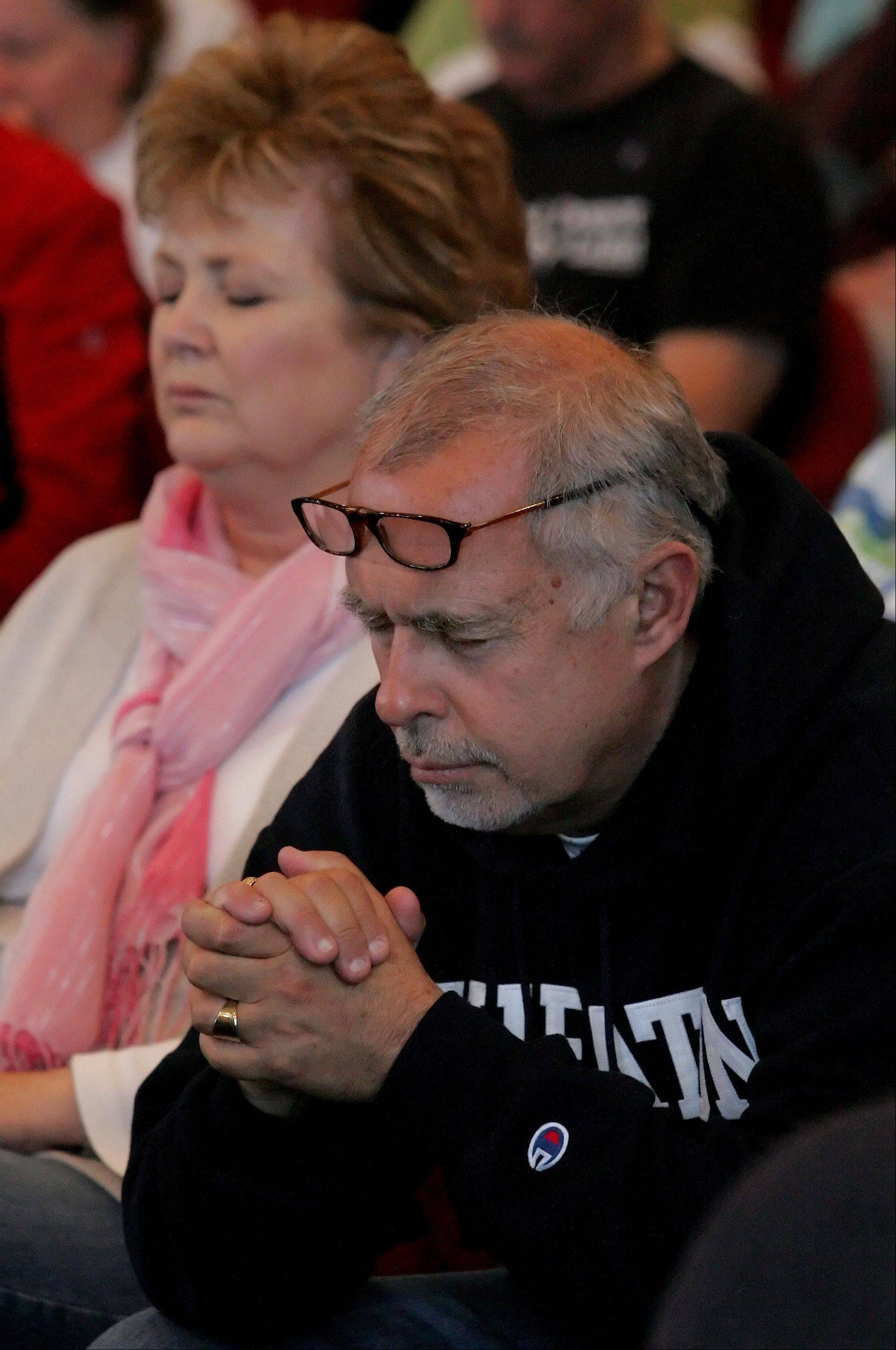 The Rev. Greg Asimakoupoulos and his wife, Wendy, take part in a National Day of Prayer in Naperville. A former Daily Herald community columnist, Asimakoupoulos says he takes comfort in his faith and poetry as he recalls the events of Sept. 11.