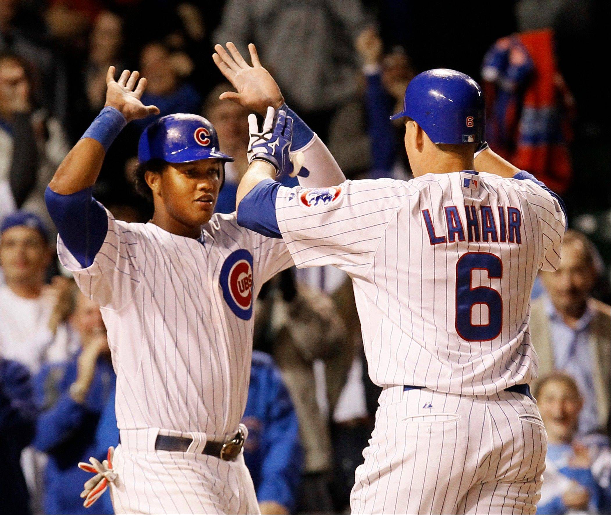 Bryan LaHair, right, celebrates with Starlin Castro after the pair scored on LaHair's game tying, 2-run home run in the ninth inning Tuesday at Wrigley Field during the Cubs' 3-2 loss to Cincinnati.
