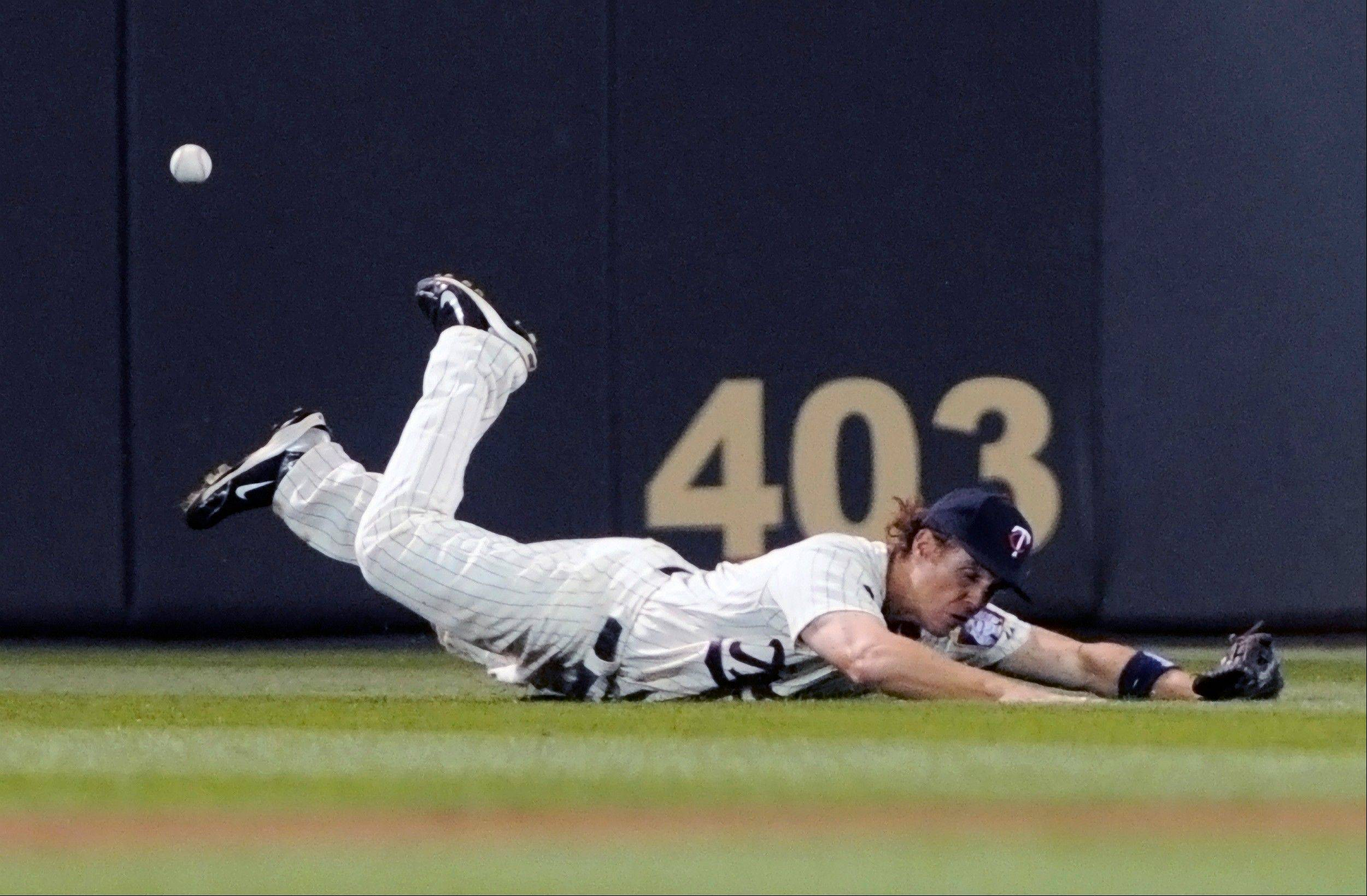 Minnesota Twins center fielder Joe Benson, in his major league debut, makes a dive for but can�t catch a triple by Chicago White Sox� Alejandro De Aza during the fifth inning of a baseball game Tuesday in Minneapolis.