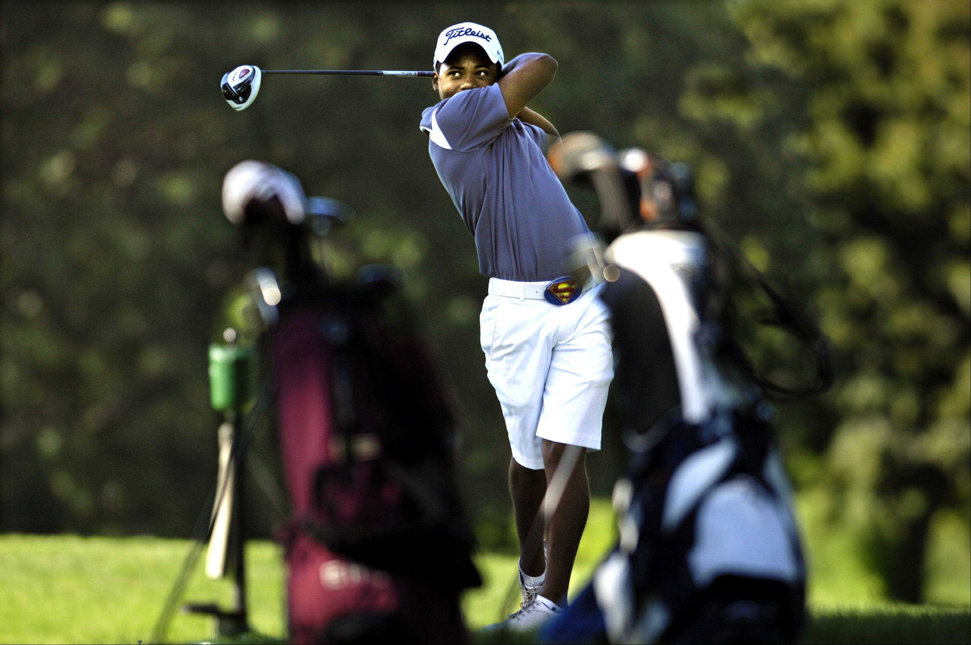 South Elgin's Xavier Owens tees off during the Elgin Country Club invitational Tuesday. Owens finished second with a 75.