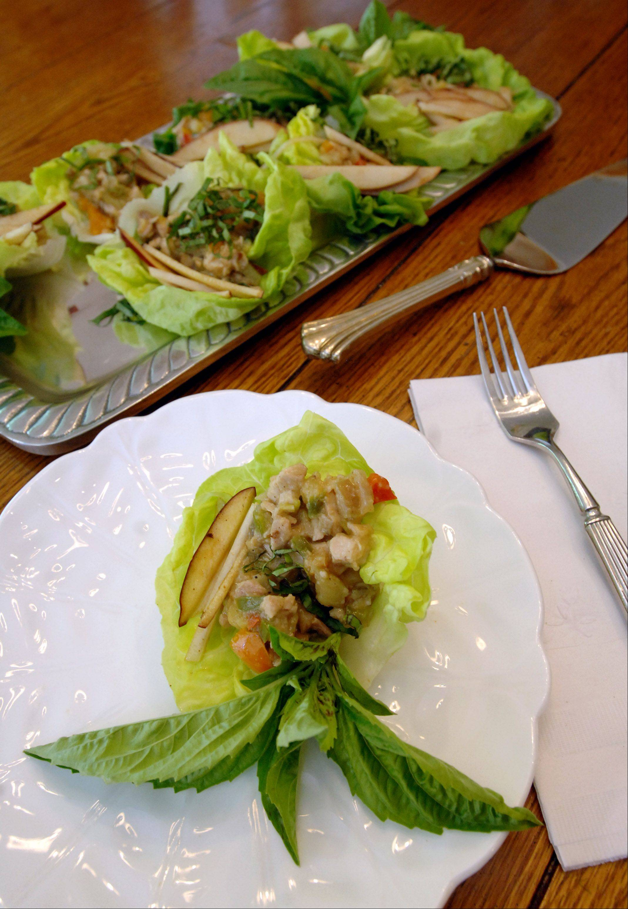 "Paul Valade/pvalade@dailyherald.comDiane Hagopian's ""Surprise Lettuce Wraps"" with Ying's Kungpao sauce, chicken thighs, apples and kohlrabi."