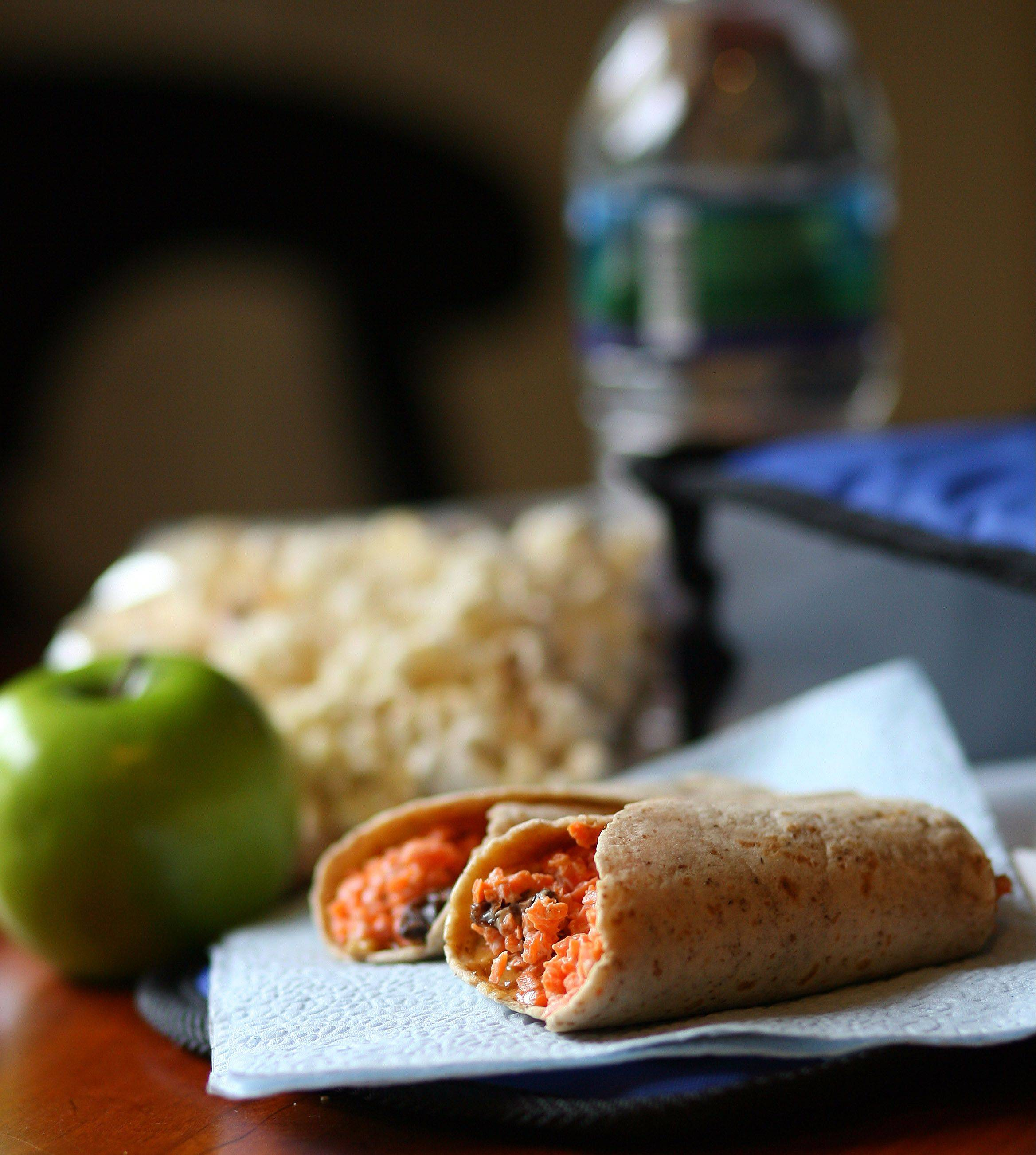 Whole-grain tortilla stuffed with carrots and raisins will refuel kids for anternoon learning.