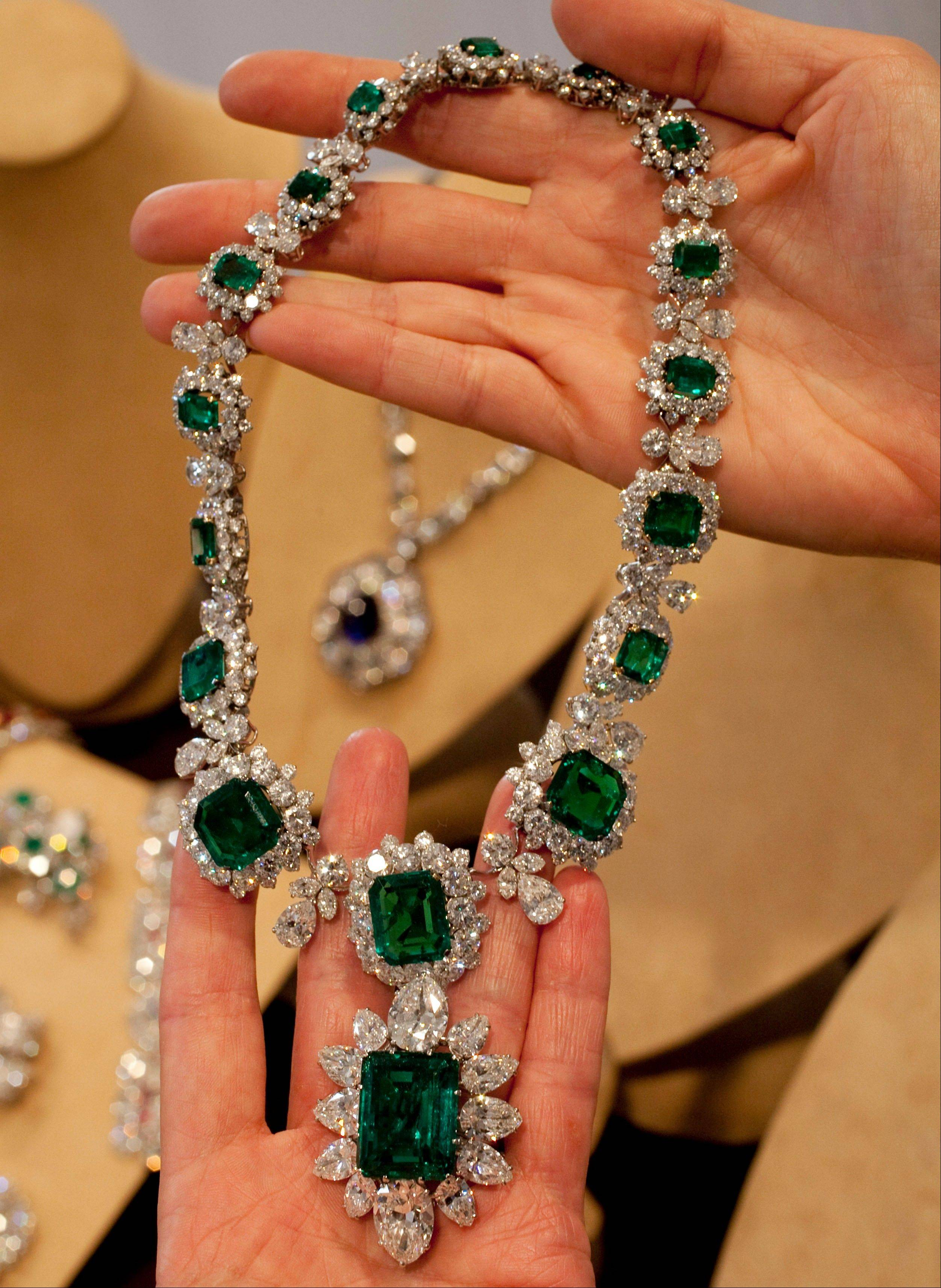 Elizabeth Taylor's emerald and diamond necklace and pendant, attached at the bottom were a gift from actor Richard Burton. Christie's auction house is selling her complete jewelry collection in New York on Dec. 13-14.