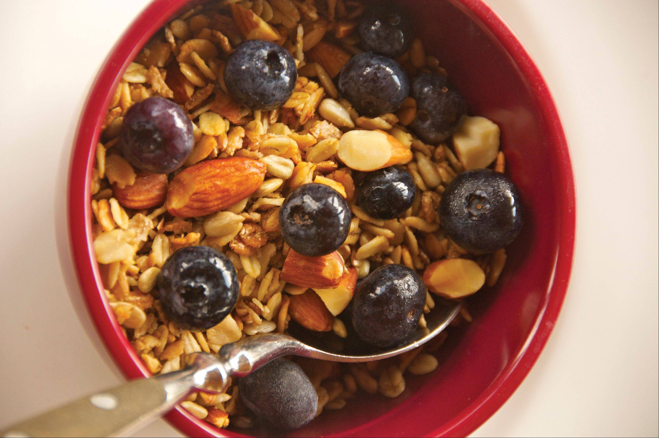 A few fresh blueberries are the only addition needed to this simple homemade granola.