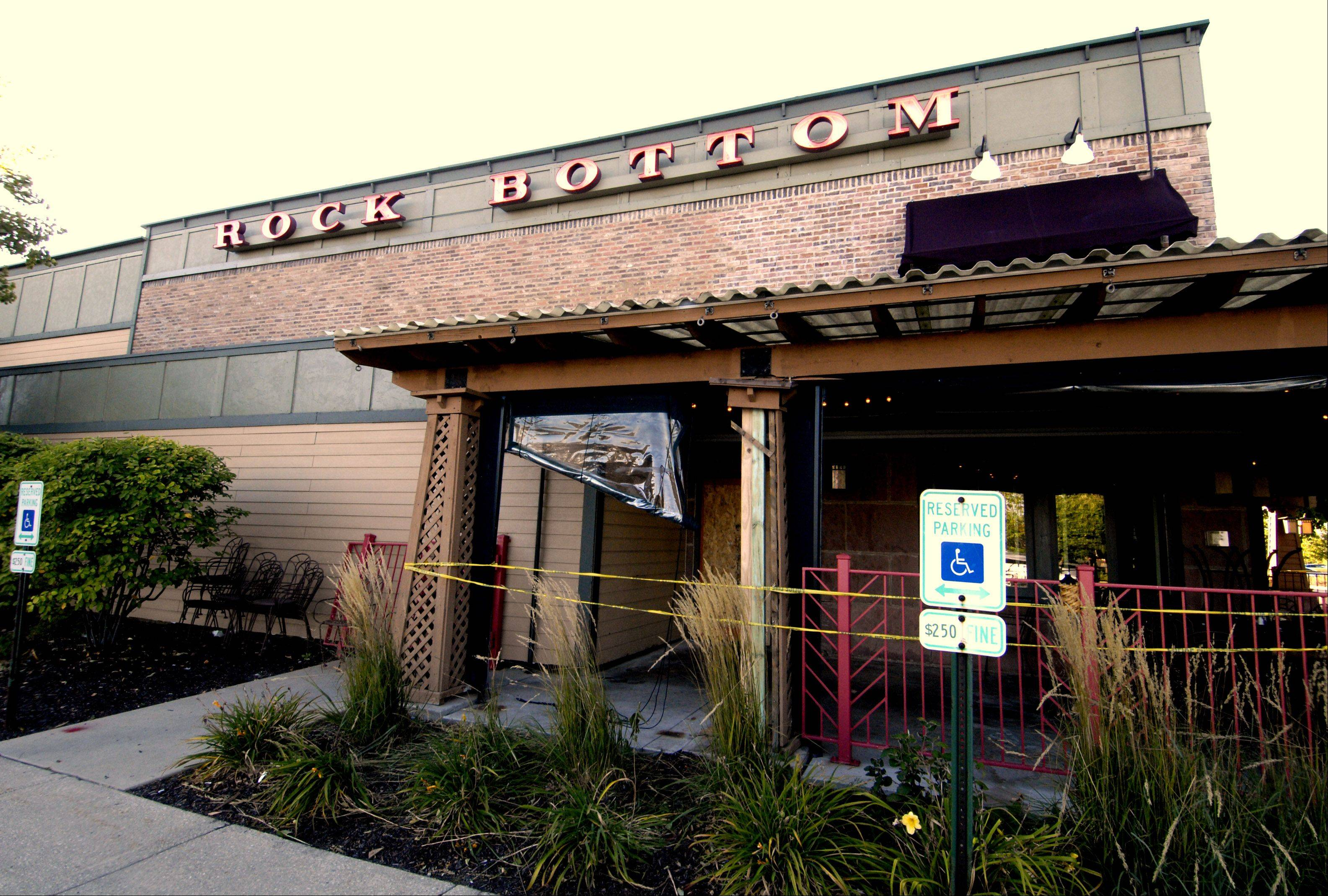 A car crashed into the outdoor dinning area of the Rock Bottom restaurant in Warrenville Wednesday afternoon. Five people were injured, two of them seriously, during the lunchtime crash.