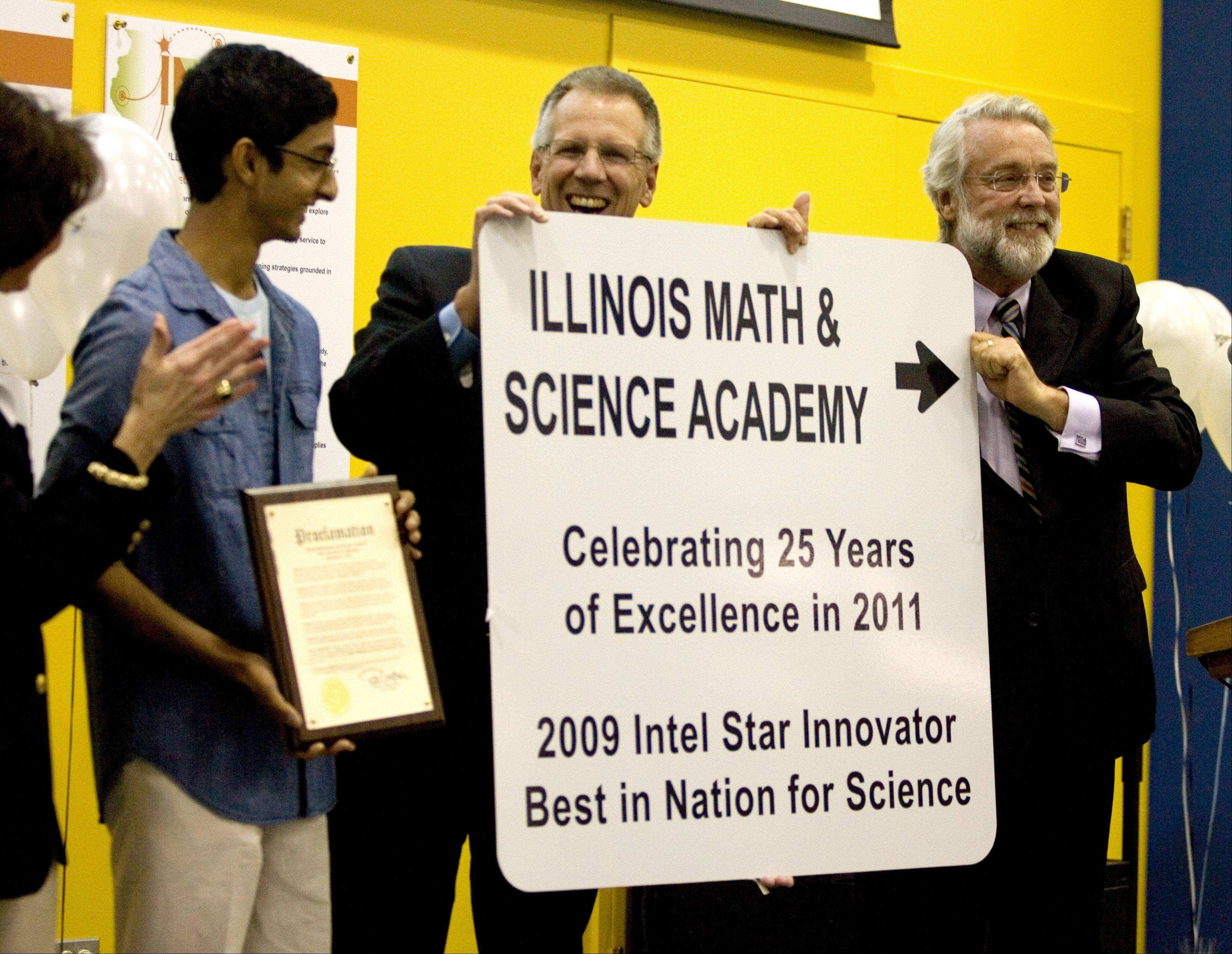 Illinois Mathematics and Science Academy student council President Aadi Tolappa, President Max McGee and Aurora Mayor Tom Weisner unveil a road sign honoring IMSA during the school�s 25th birthday ceremony Wednesday.