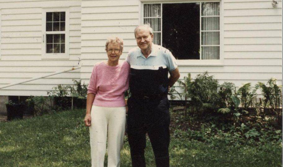 Mary Lou Reynolds and her brother, Bob Link, in front of their old home.