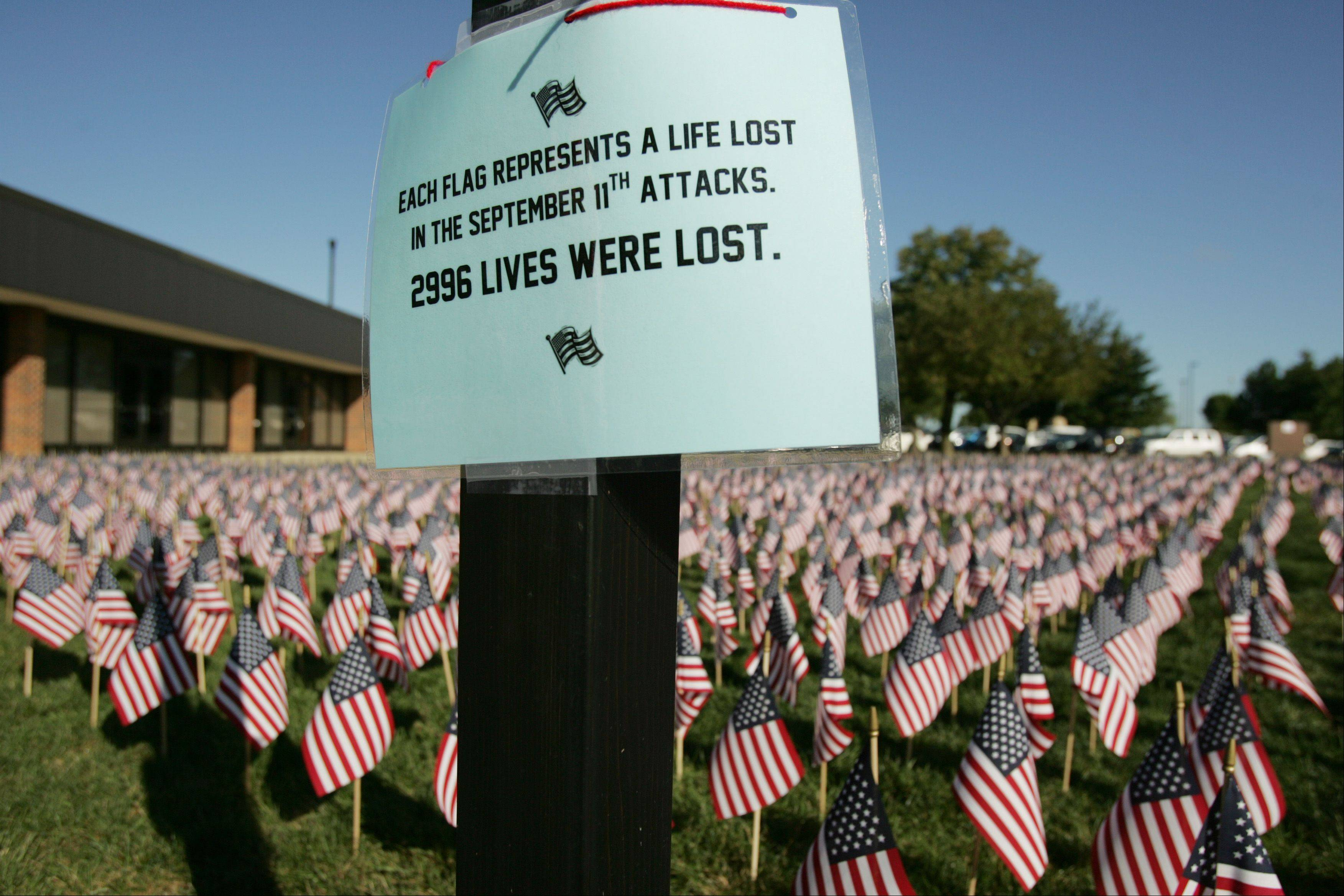 McHenry County College commemorated the 10th anniversary of the attacks of Sept. 11, 2001, with a ceremony at the Crystal Lake campus Wednesday. Some 2,996 flags were placed in the courtyard to honor every life lost that day.