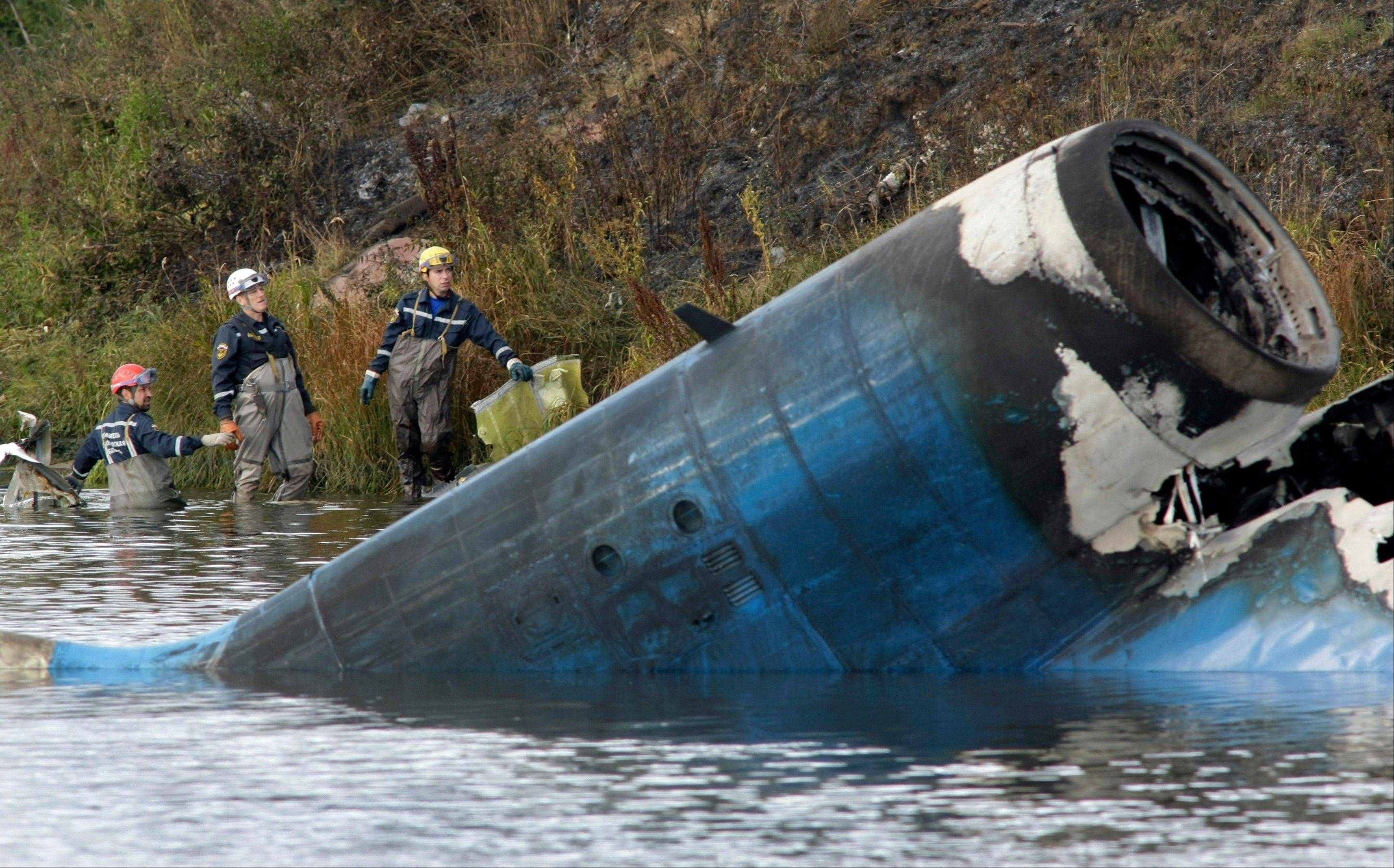 Rescuers work at the crash site of a Russian Yak-42 jet near the city of Yaroslavl, on the Volga River about 150 miles northeast of Moscow, Russia. The Yak-42 jet was carrying the Lokomotiv ice hockey team. At least 43 are dead, with 2 others critically injured.