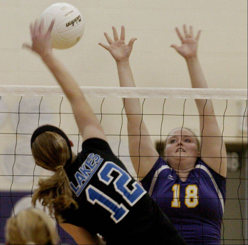 Ali Morrison of Wauconda goes up for a block against Lakes� Sarah Horner during Lakes at Wauconda volleyball.