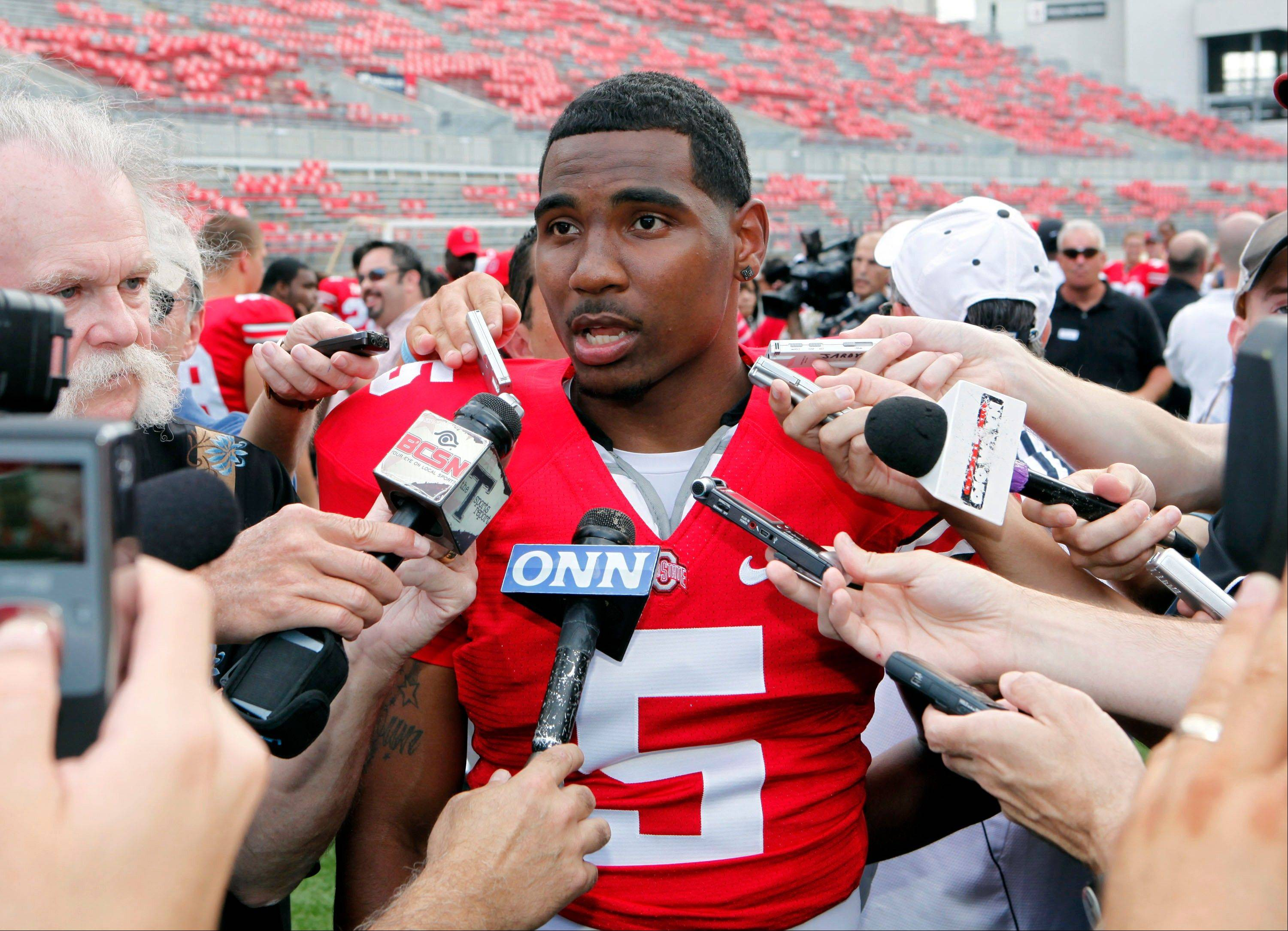 Ohio State quarterback Braxton Miller talks to reporters during an NCAA college football photo day in Columbus, Ohio. In the darkest days of Ohio State's seemingly endless NCAA investigation into players selling memorabilia, Buckeyes fans longed for a breath of fresh air, for some hope. They've gotten it in the form of a freshman class that has been the scourge of preseason camp, in a good way.