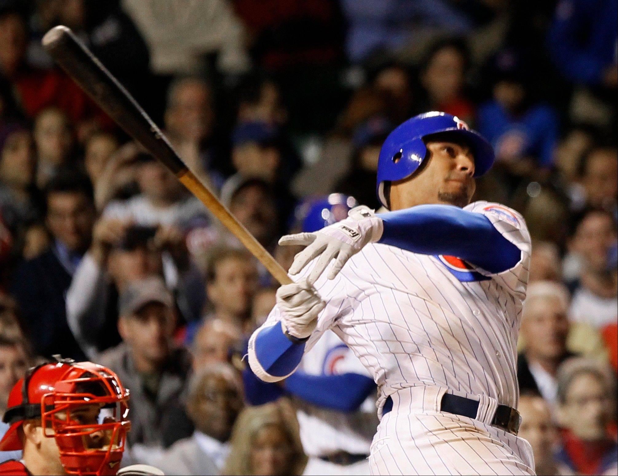 Carlos Pena launches a 3-run home run off Cincinnati Reds relief pitcher Bill Bray to score Starlin Castro and Aramis Ramirez during the eighth inning of the Cubs' win Wednesday.