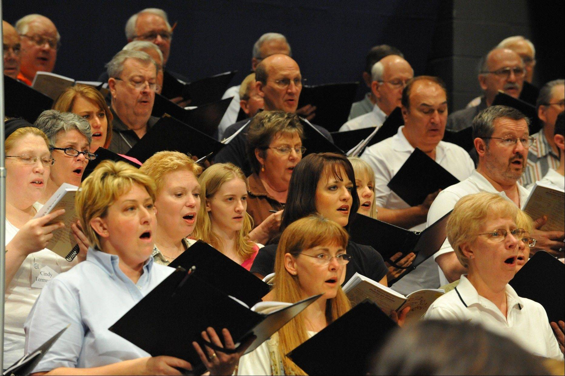 "Members of the Elgin Choral Union rehearse for ""A Concert of Remembrance"" to be performed on Sunday, Sept. 11, at the Hemmens Cultural Center in Elgin."