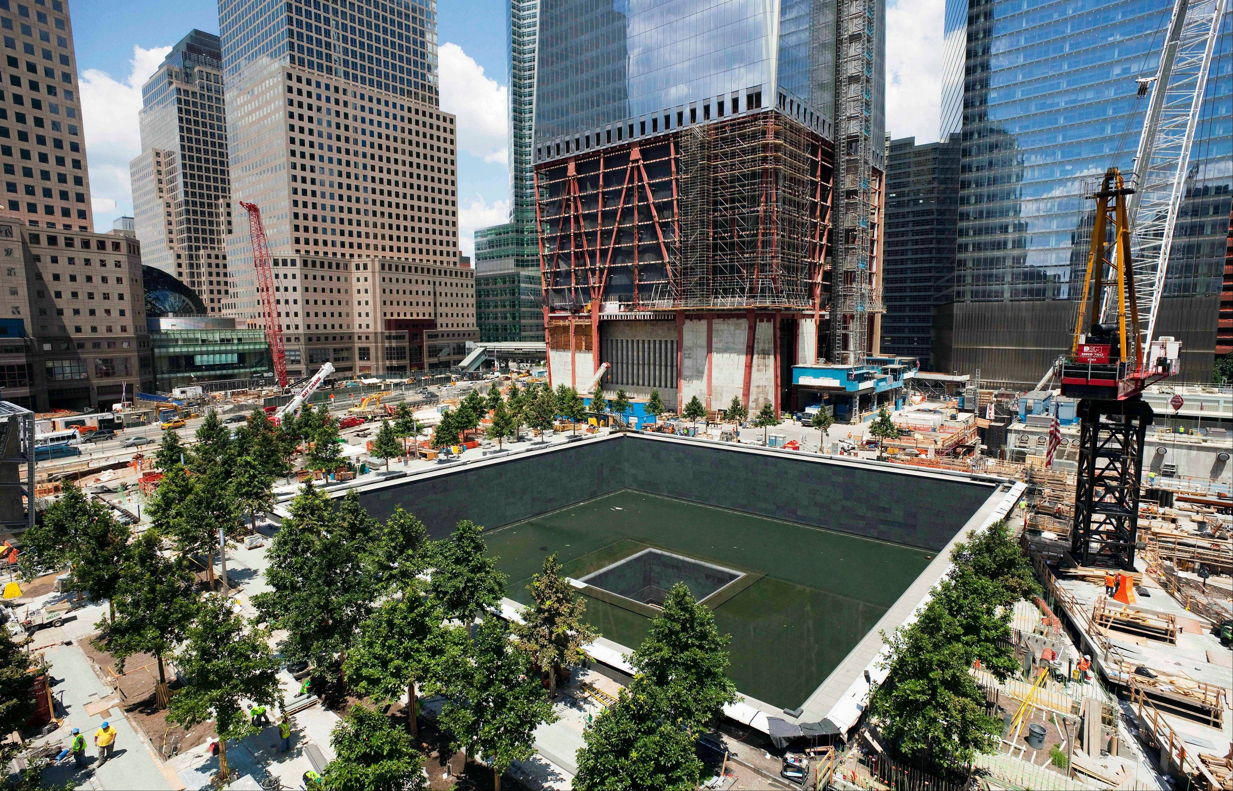 In this July 15, 2011 file photo, work continues on the National September 11 Memorial at the World Trade Center site in New York. The memorial is scheduled to open to the public on Sept. 12, 2011.