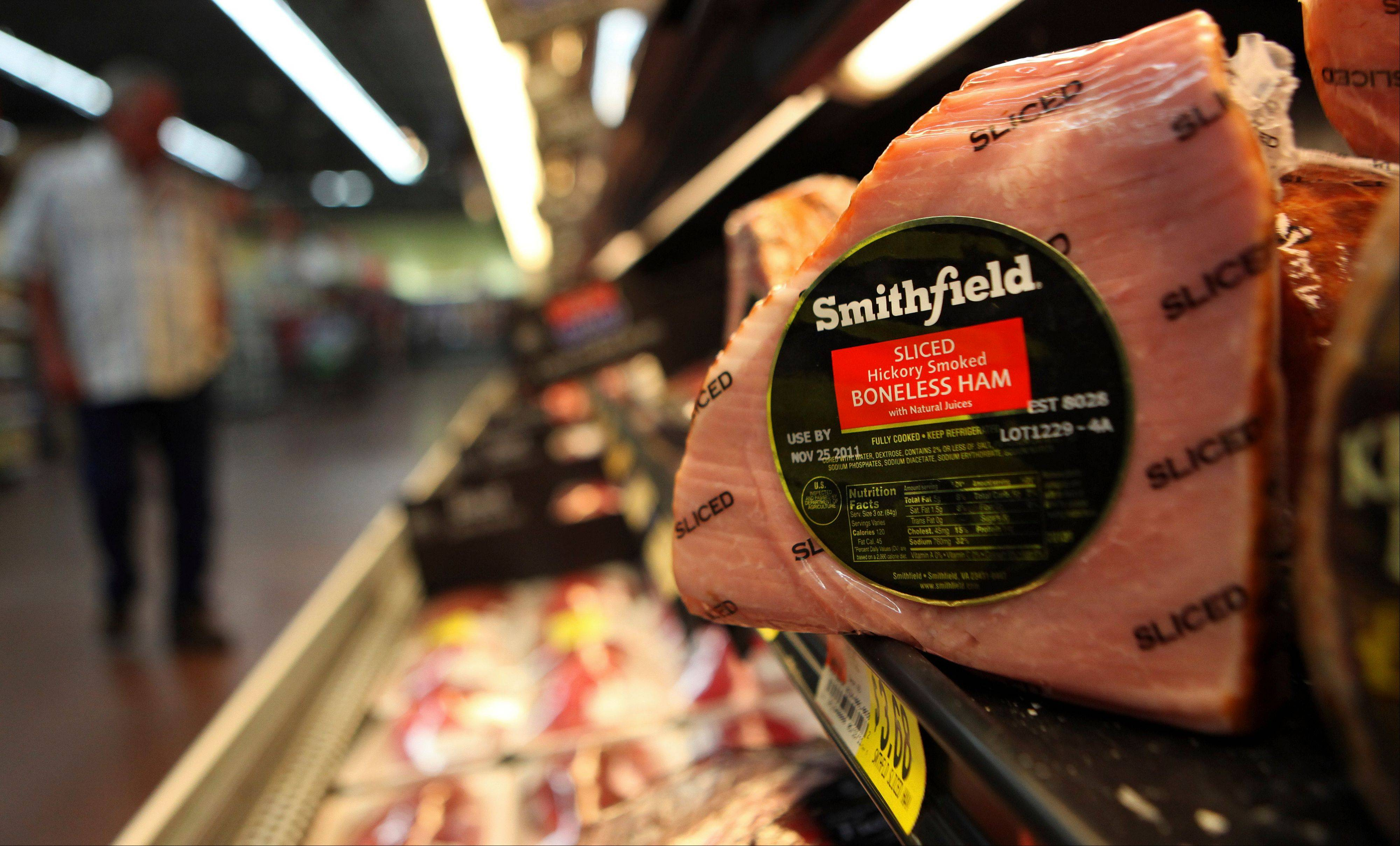 A Smithfield ham at a grocery store in Richardson, Texas. Smithfield Foods Inc.'s fiscal first-quarter net income rose 8 percent, as the world's biggest hog producer charged higher prices and sold more packaged meats. Associated Press