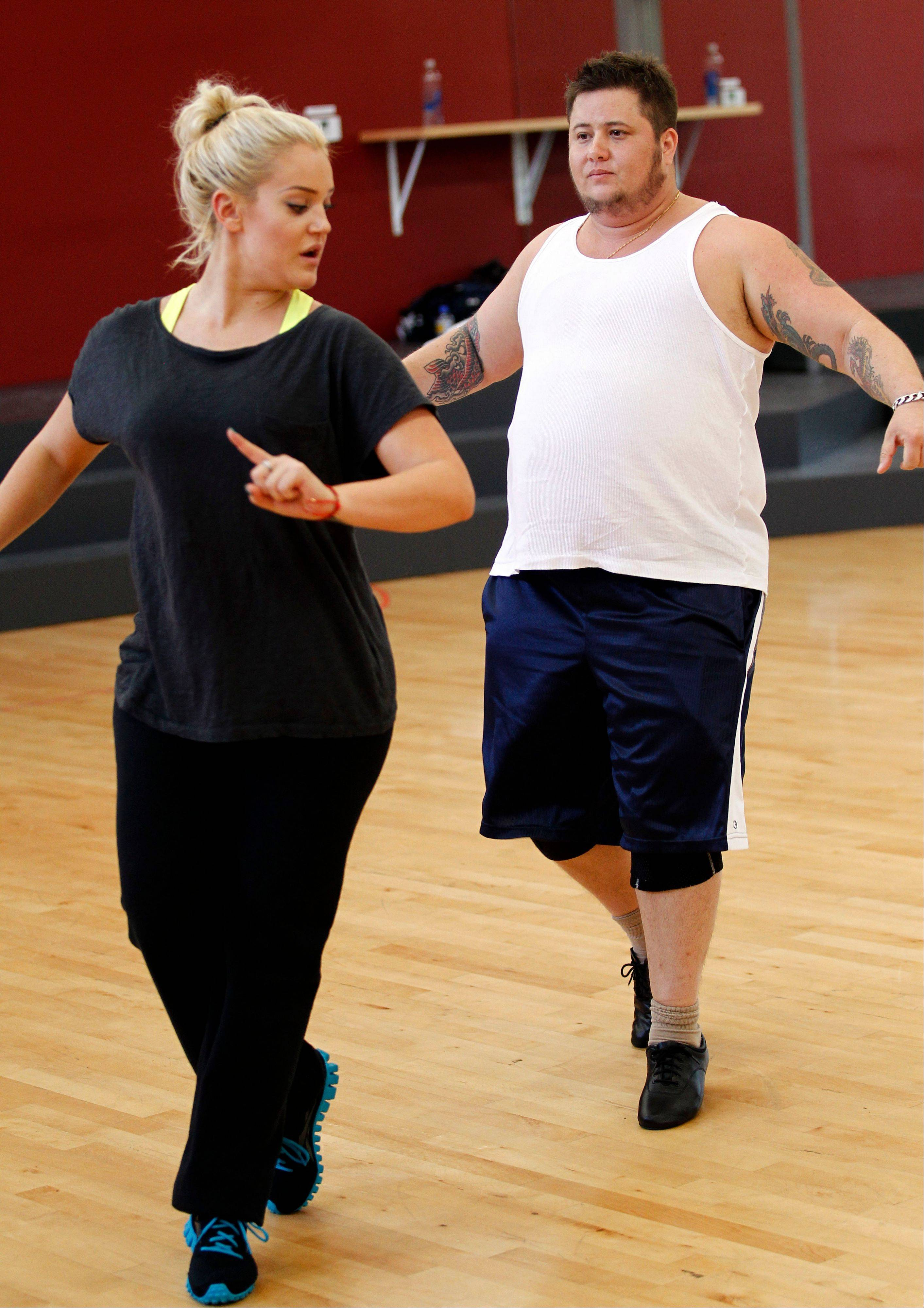 "Chaz Bono, right, and Lacey Schwimmer practice dance steps Wednesday while rehearsing for the upcoming season of ABC's ""Dancing of the Stars,"" which premieres Sept. 19. Bono says he's focusing on dancing instead of the controversy surrounding his casting on the show."