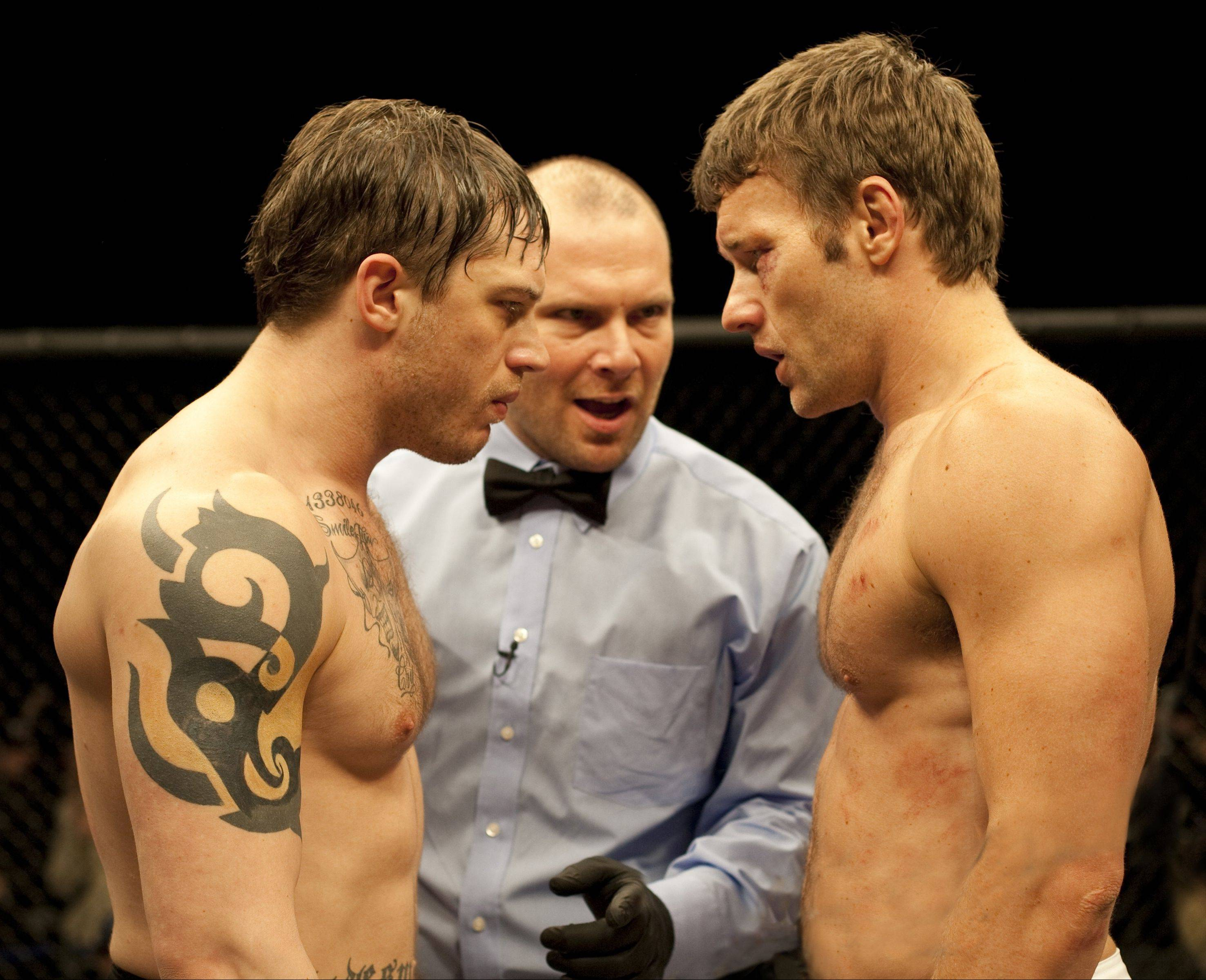 "Ex-Marine Tommy (Tom Hardy), left, and his ex-physics teacher brother Brendan (Joel Edgerton) face off for a $5 million mixed martial arts sports match in Gavin O'Connor's ""Warrior."""