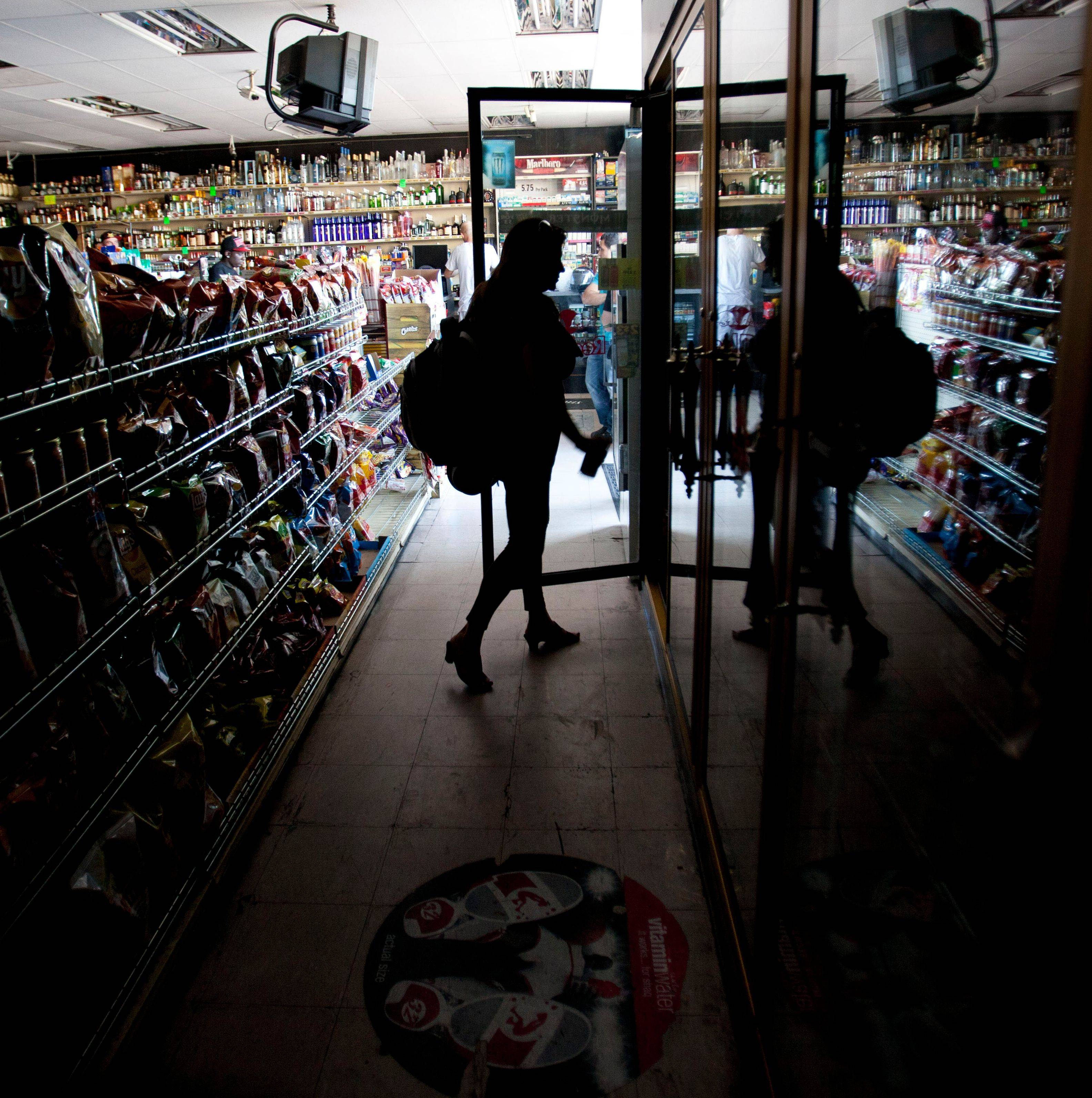 Customers shop in a convenience store after a power outage Thursday in San Diego that affected California, Arizona and Mexico.