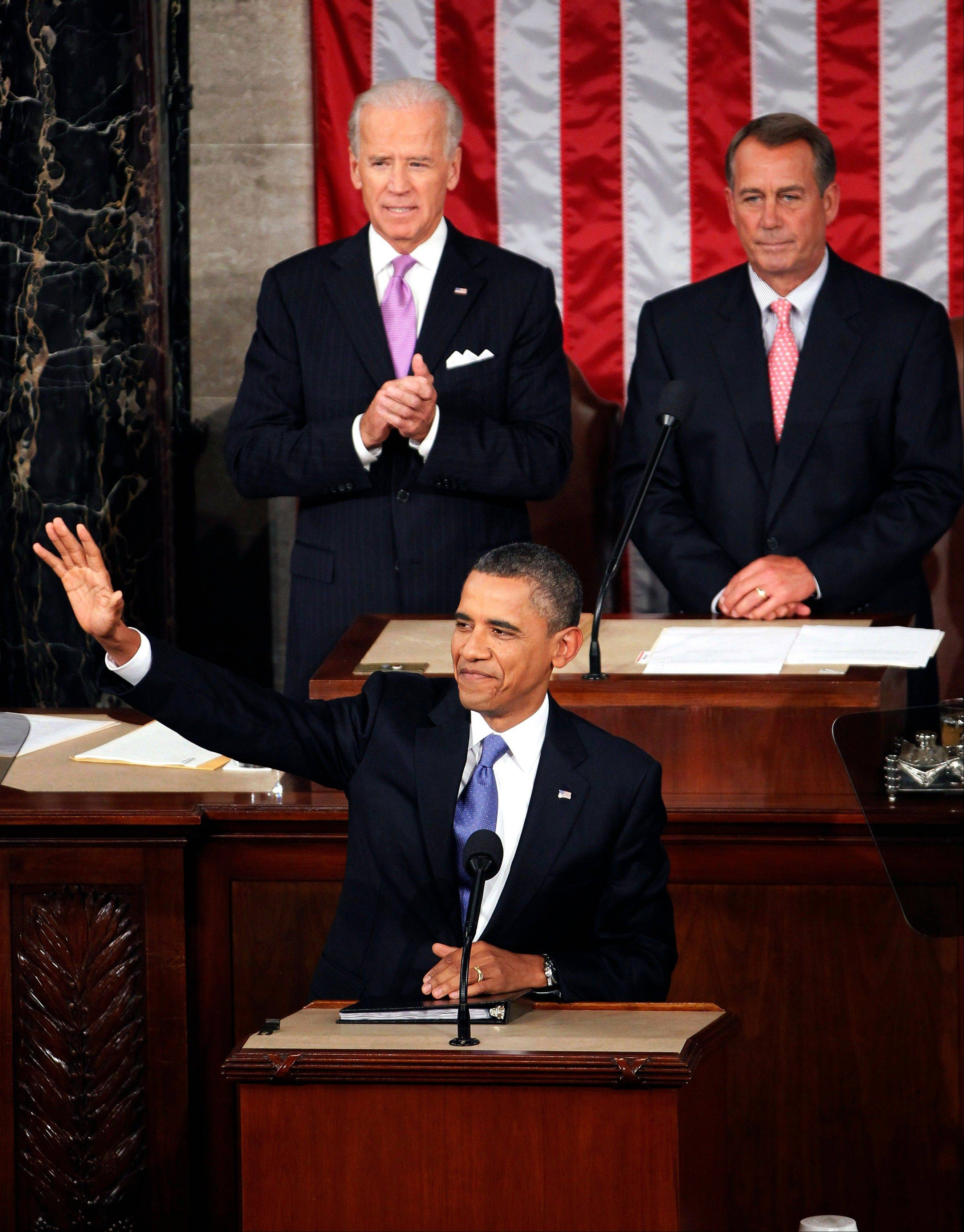 President Barack Obama arrives Thursday to deliver a speech to a joint session of Congress at the Capitol in Washington. Watching are Vice President Joe Biden and House Speaker John Boehner.