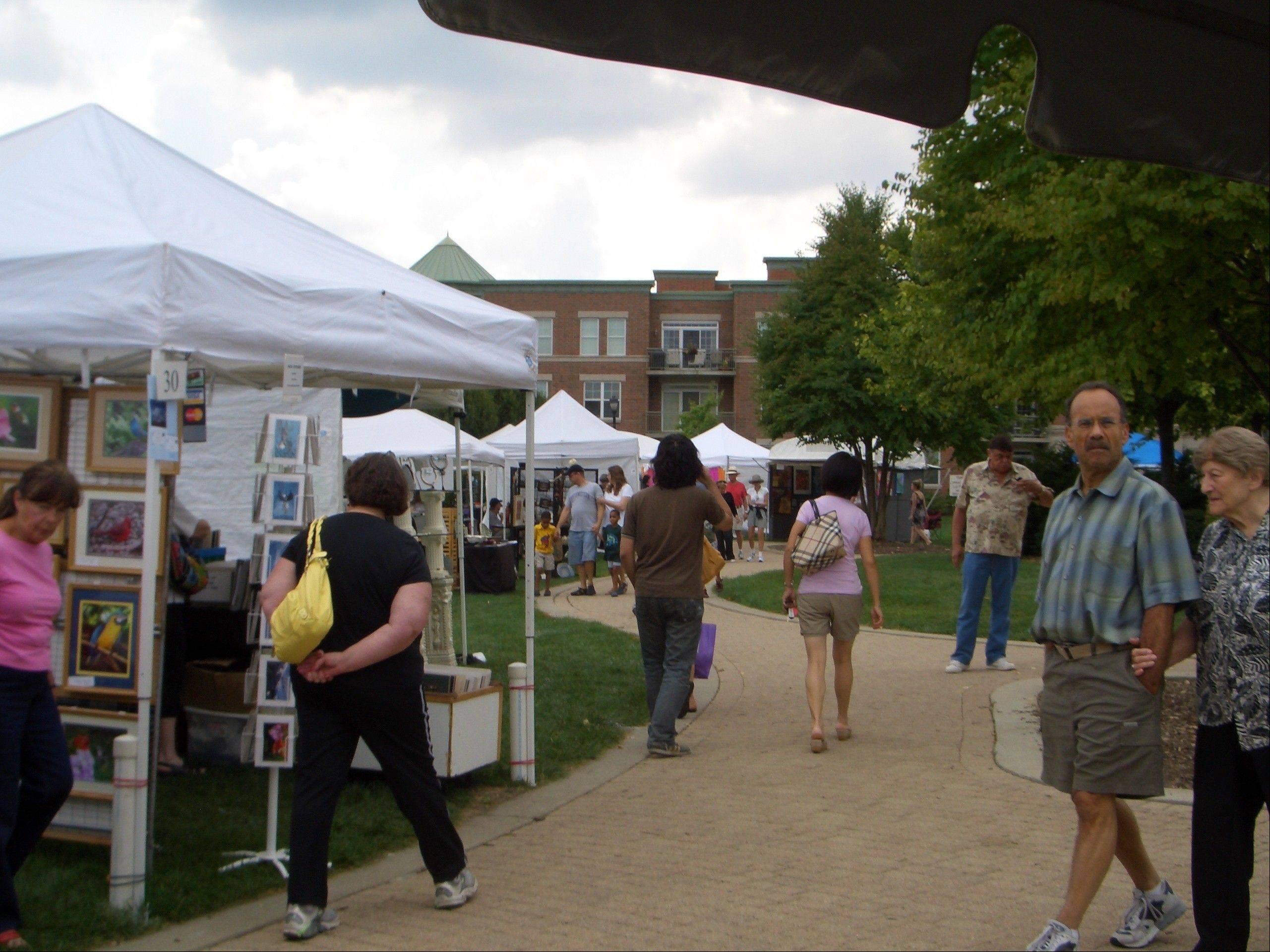 Visitors browse the juried art during a previous Art Affair Around the Square event.