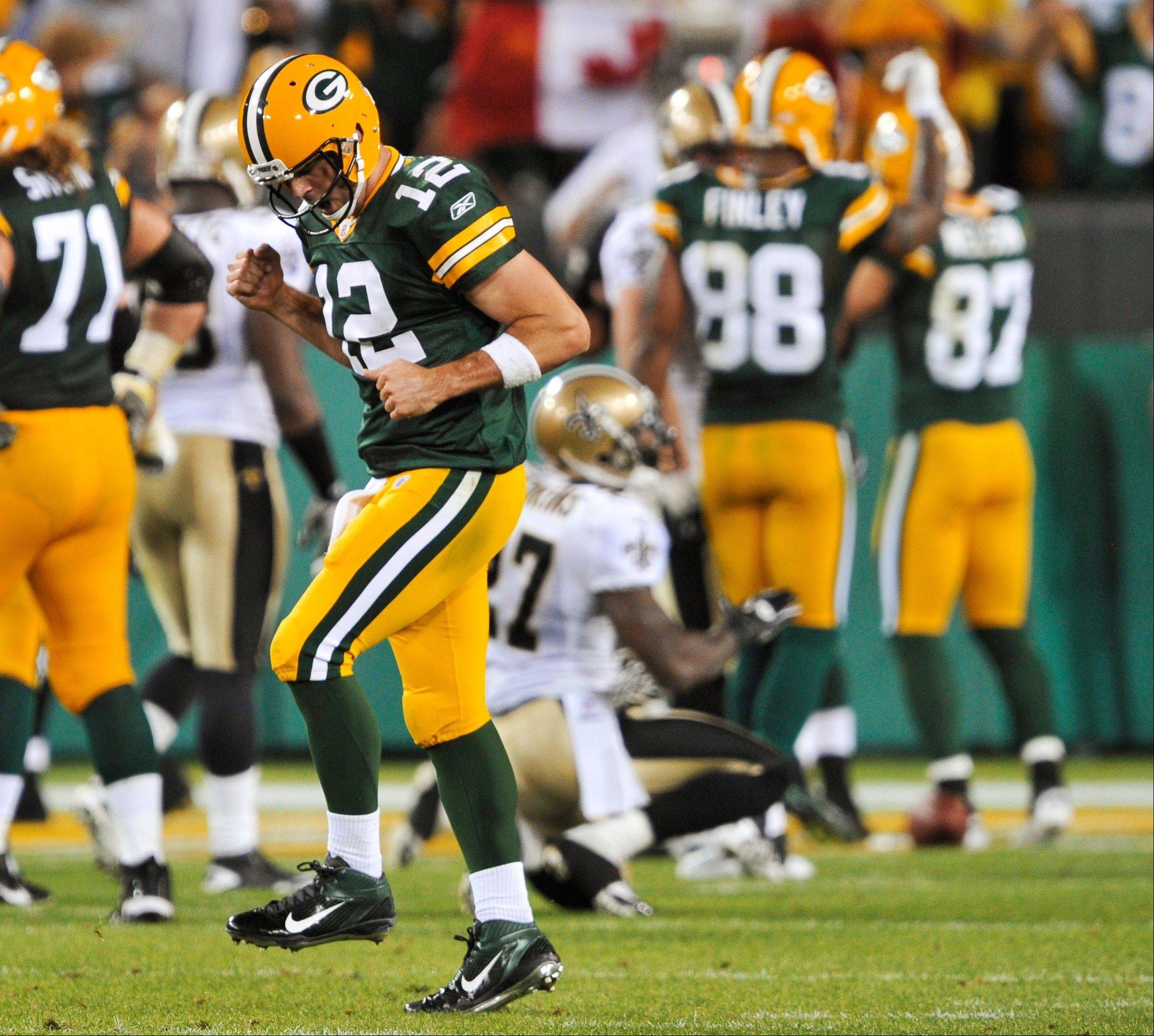 Green Bay Packers' Aaron Rodgers reacts after James Starks ran for a touchdown during the first half Thursday night.