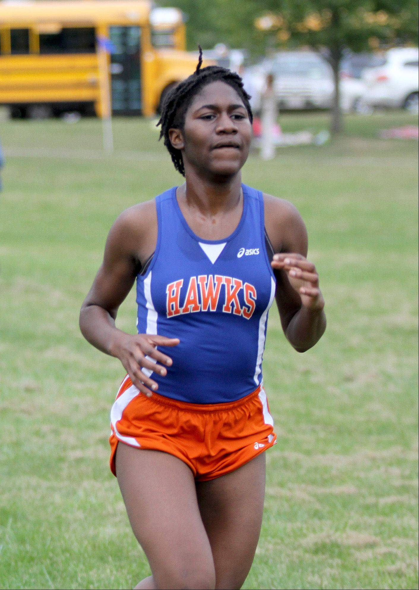Tyra Palmer, a junior from Hoffman Estates, crosses the finish line in underlevel cross country at Barrington Thursday afternoon.