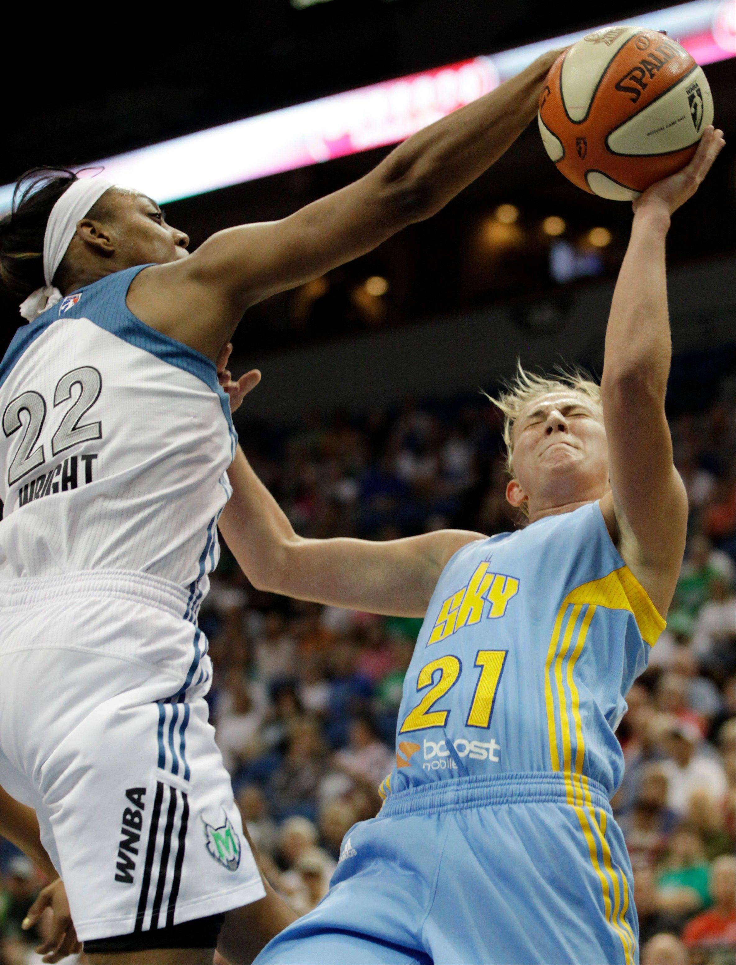 Minnesota Lynx guard Monica Wright drives hard against Sky guard Courtney Vandersloot. The Sky dropped the game against the Lynx, 78-69.
