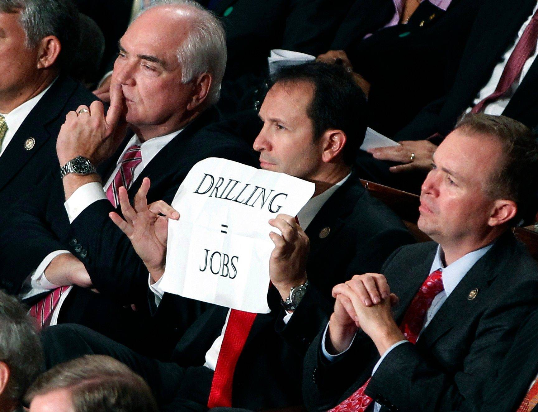 Rep. Jeff Landry, R-La., holds a sign during a speech by President Barack Obama to a joint session of Congress at the Capitol in Washington, Thursday, Sept. 8, 2011.