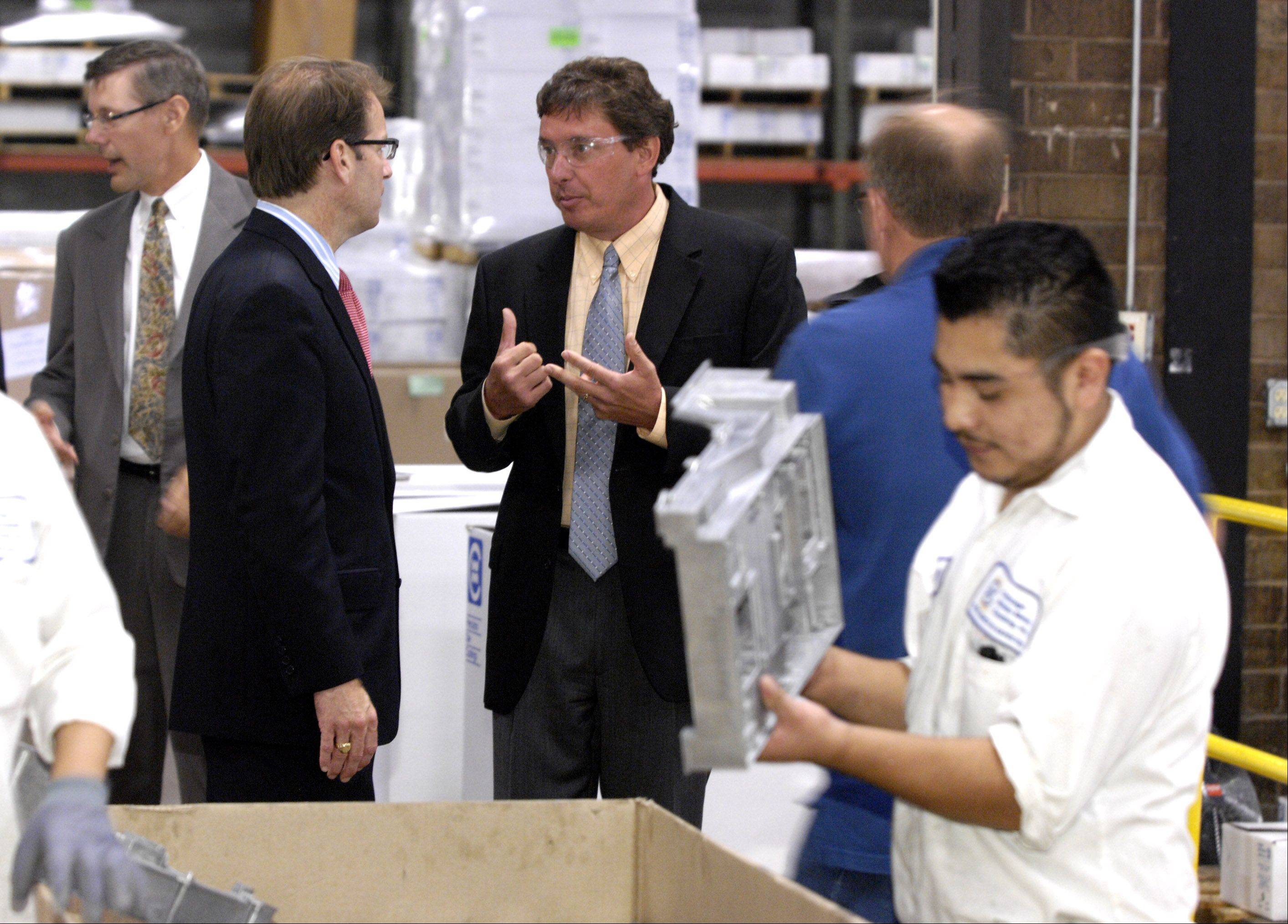 Congressman Peter Roskam, left center, tours Bensenville's Chicago White Metal Casting, Inc., with its president and CEO Eric Treiber.