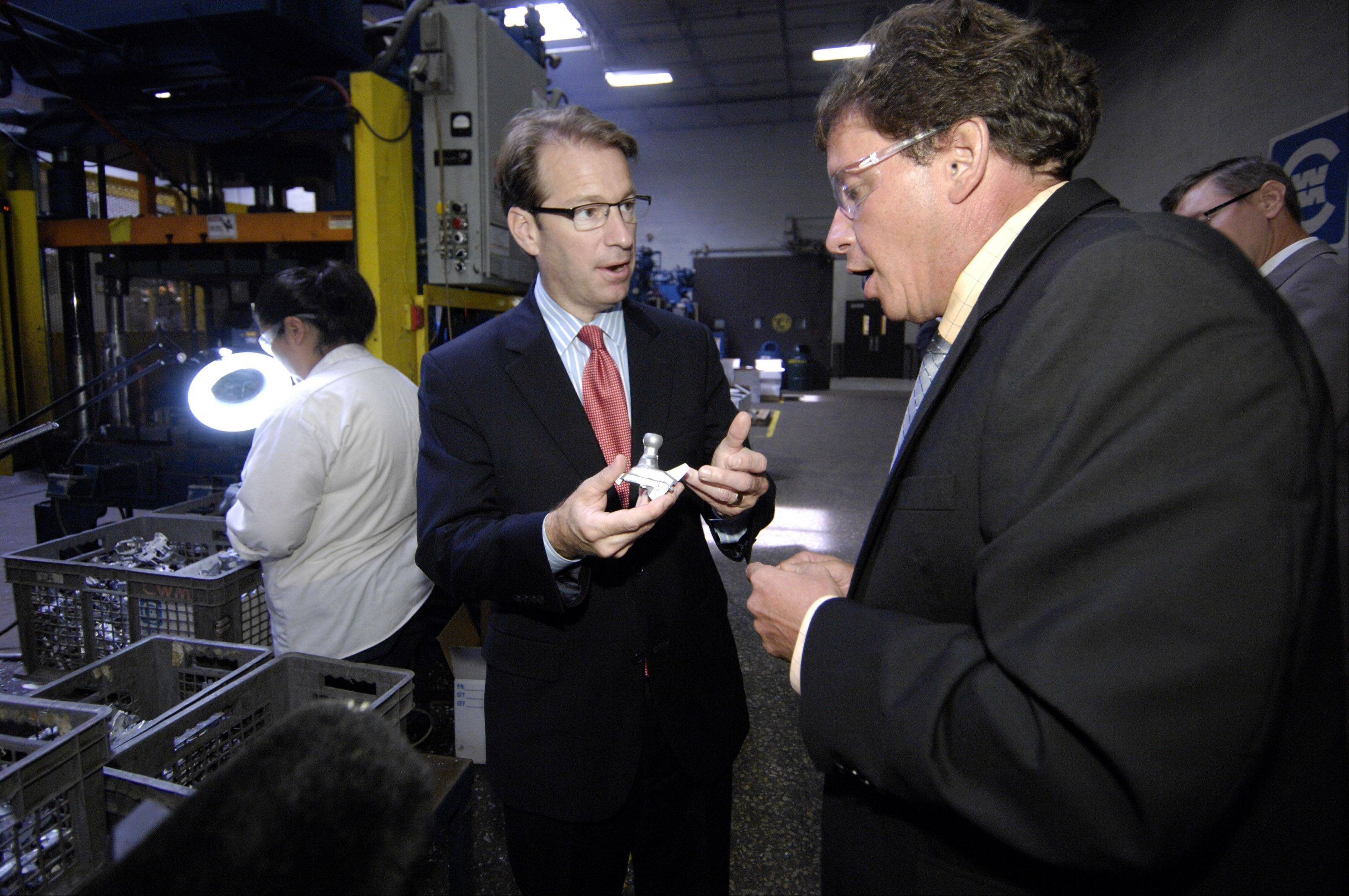 Congressman Peter Roskam, left, tours Bensenville's Chicago White Metal Casting, Inc., with its president and CEO Eric Treiber.