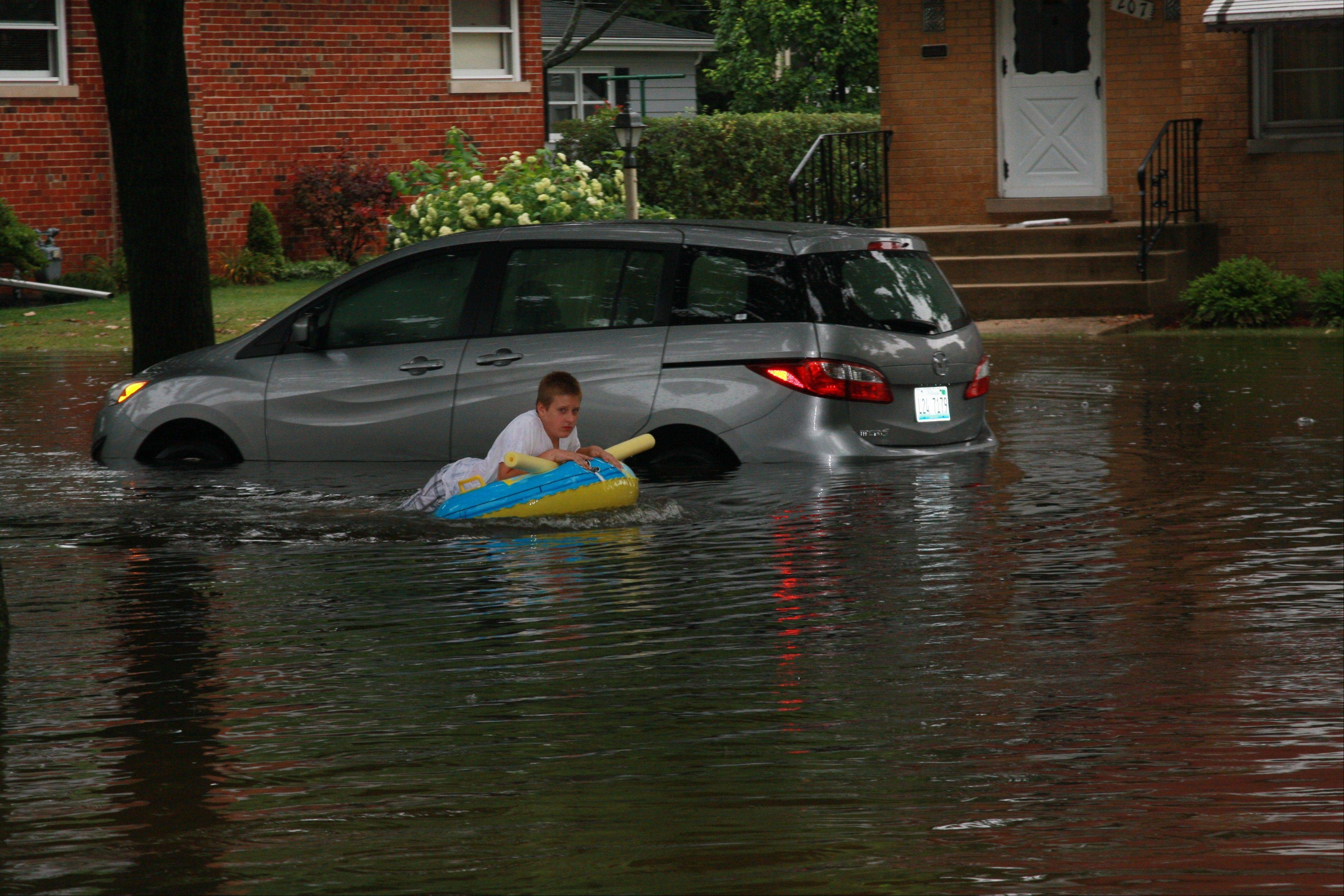 Rain water flooded the street along South Phelps Avenue in Arlington Heights on July 23.