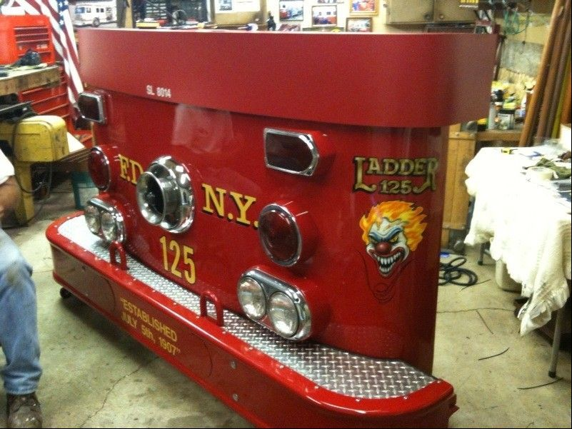 Elgin firefighter John Tobin, of West Dundee, restored the front end of an abandoned fire truck as a gift for the New York Fire Department.