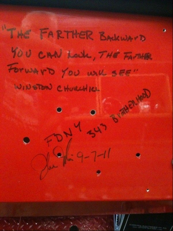 "On the back of the restored fire truck, Elgin firefighter John Tobin signed his name and wrote the Winston Churchill quote, ""The farther backward you can look, the farther forward you will see."""