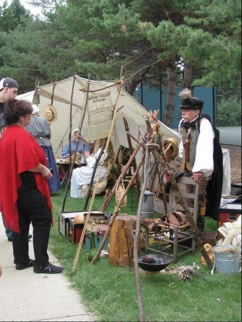 Visitors view the displays during a previous Pioneer Day event in Elk Grove Village. The Historical Museum will host this year's event from noon-4 p.m. Sunday, Sept. 18.