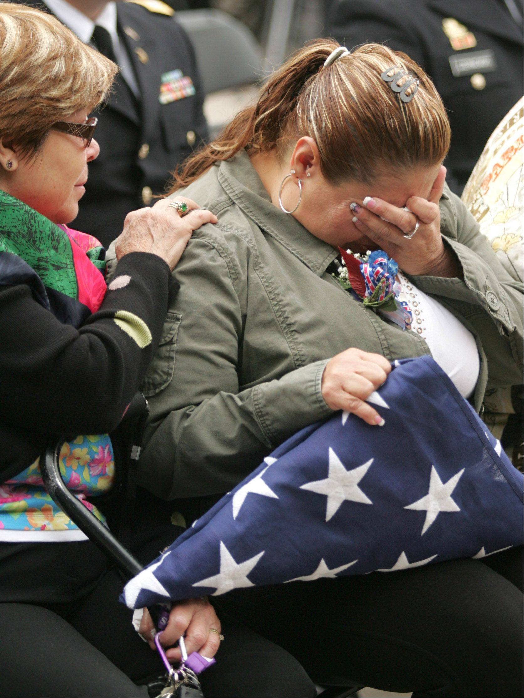 Nancy Ramos, who lost her son Hector in the Iraq War, is comforted by her mother, Irene Baker, during a ceremony Friday in Aurora marking the 10-year anniversary of the Sept. 11 attacks.