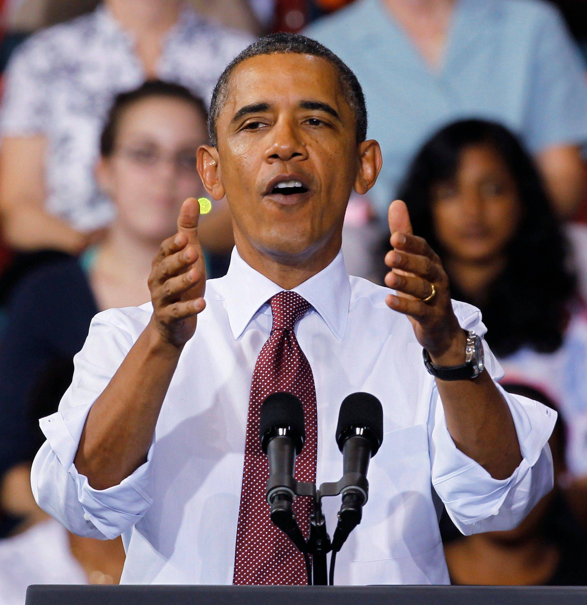 President Barack Obama urges voters to get behind his new jobs bill during a speech Friday at the University of Richmond in Virginia.