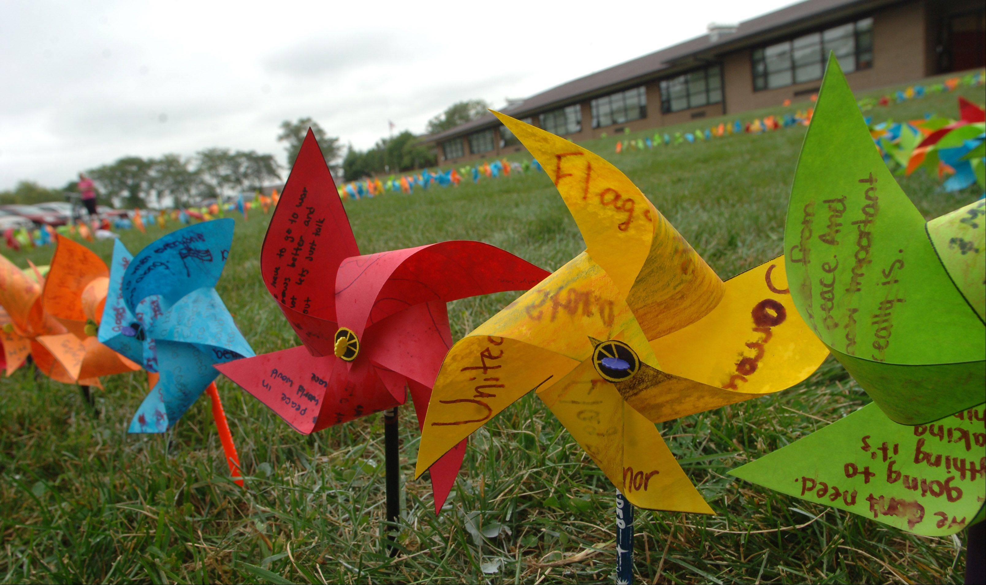 "Middle schoolers placed their 850 pinwheels outside the school Friday, as part of the ""Whirled for Peace"" project."
