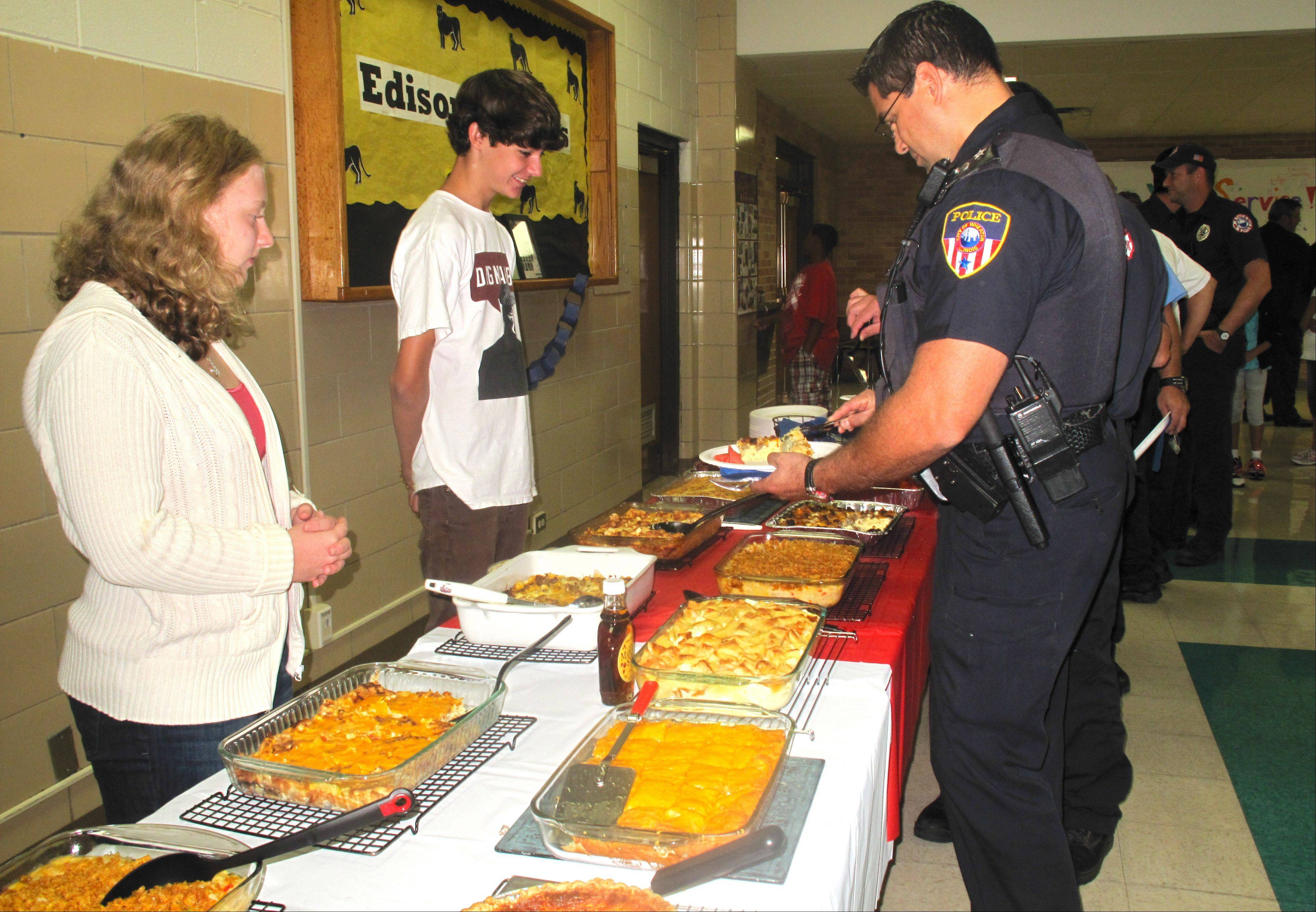 Edison Middle School students served breakfast Friday for Wheaton police and fire officials to observe the 10th anniversary of the Sept. 11 terrorist attacks.