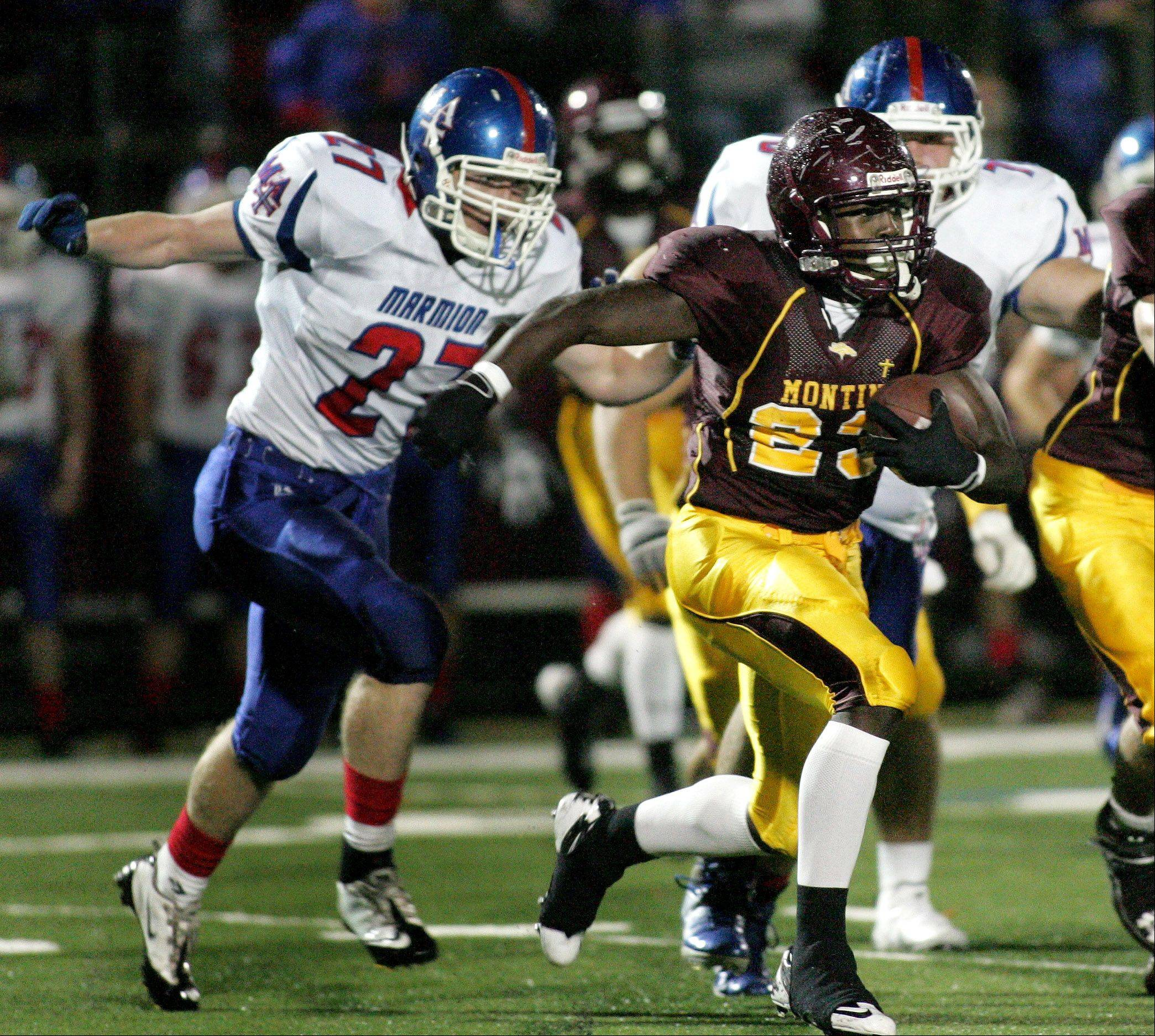 Dimitri Taylor of Montini breaks away from Marmion defense in football action Friday in Lombard.