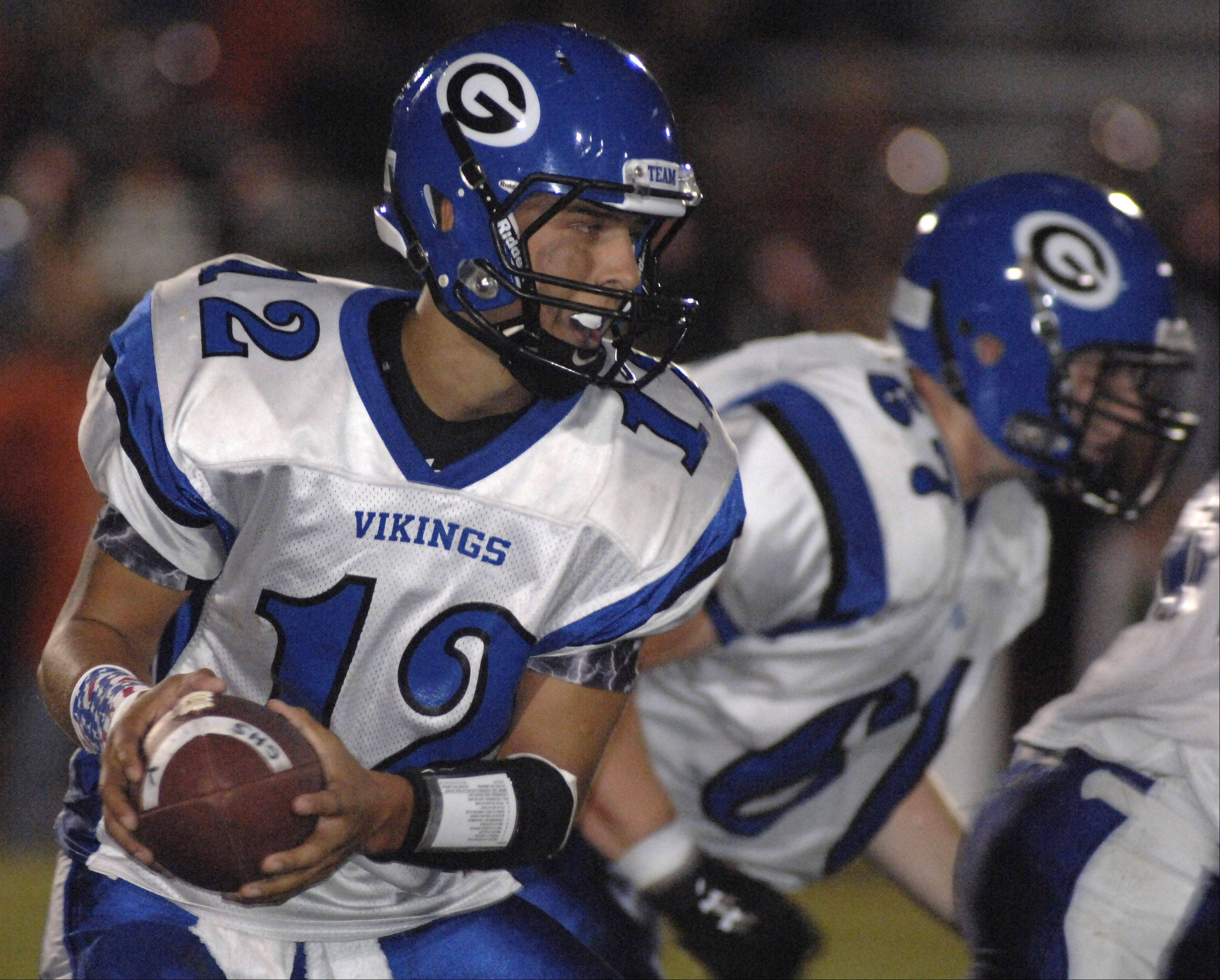 Geneva quarterback Matt Williams readies to pass off the ball on Friday, September 9.
