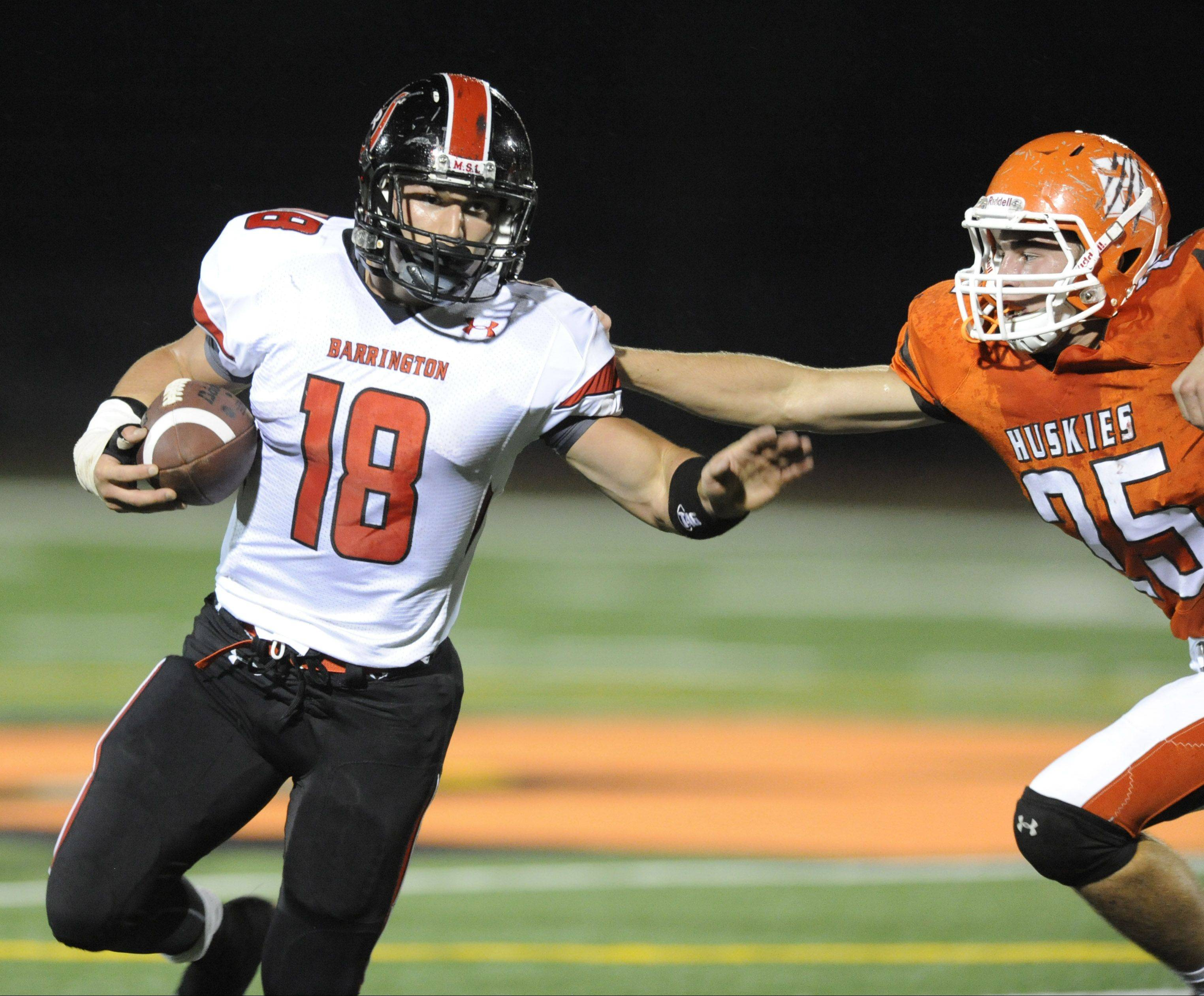 Barrington�s Chase Murdock tries to fend off Hersey defender Grant Burke.