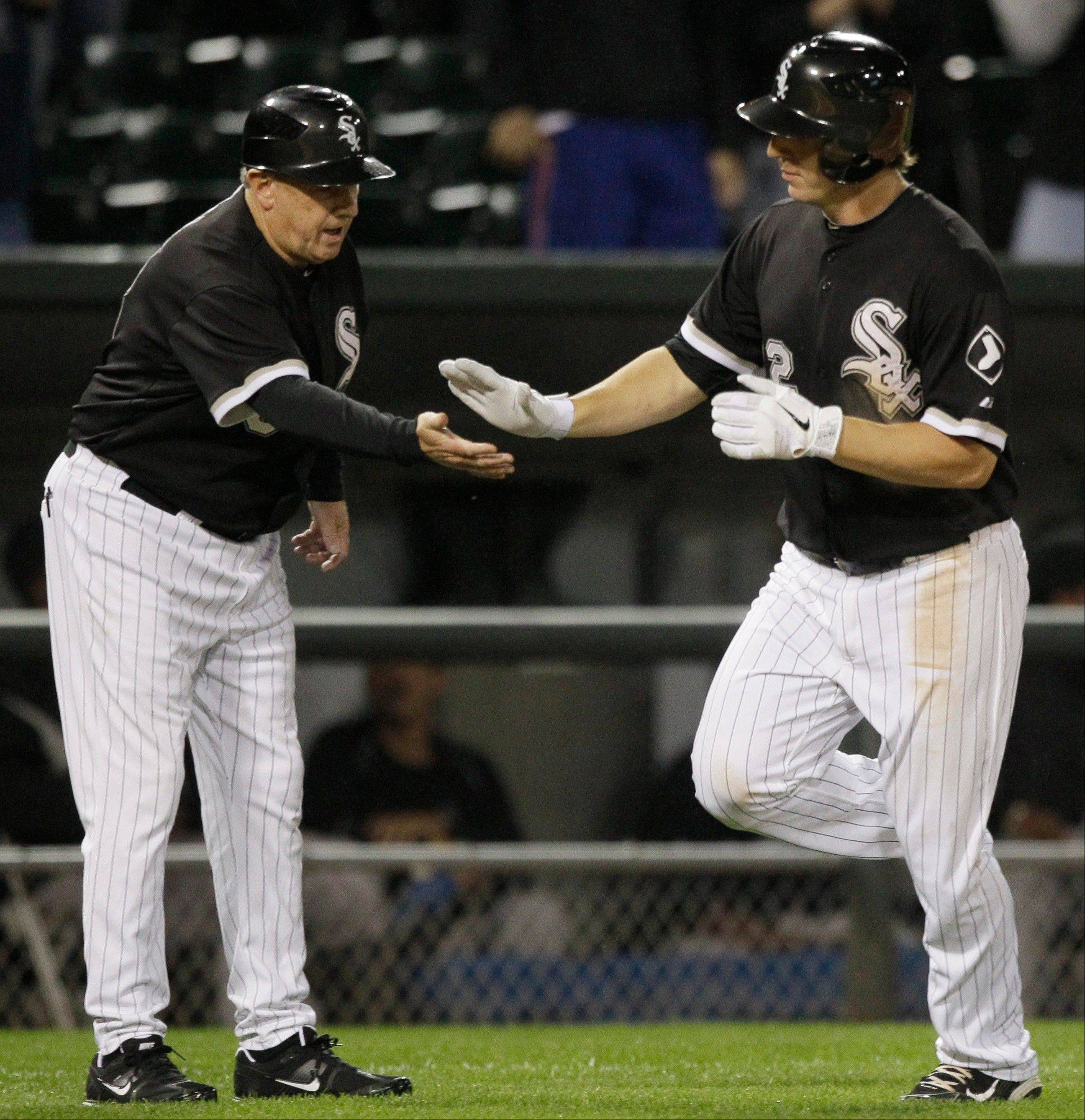 Brent Morel high fives third-base coach Jeff Cox after hitting 1 of his 2 home runs Thursday against Cleveland.