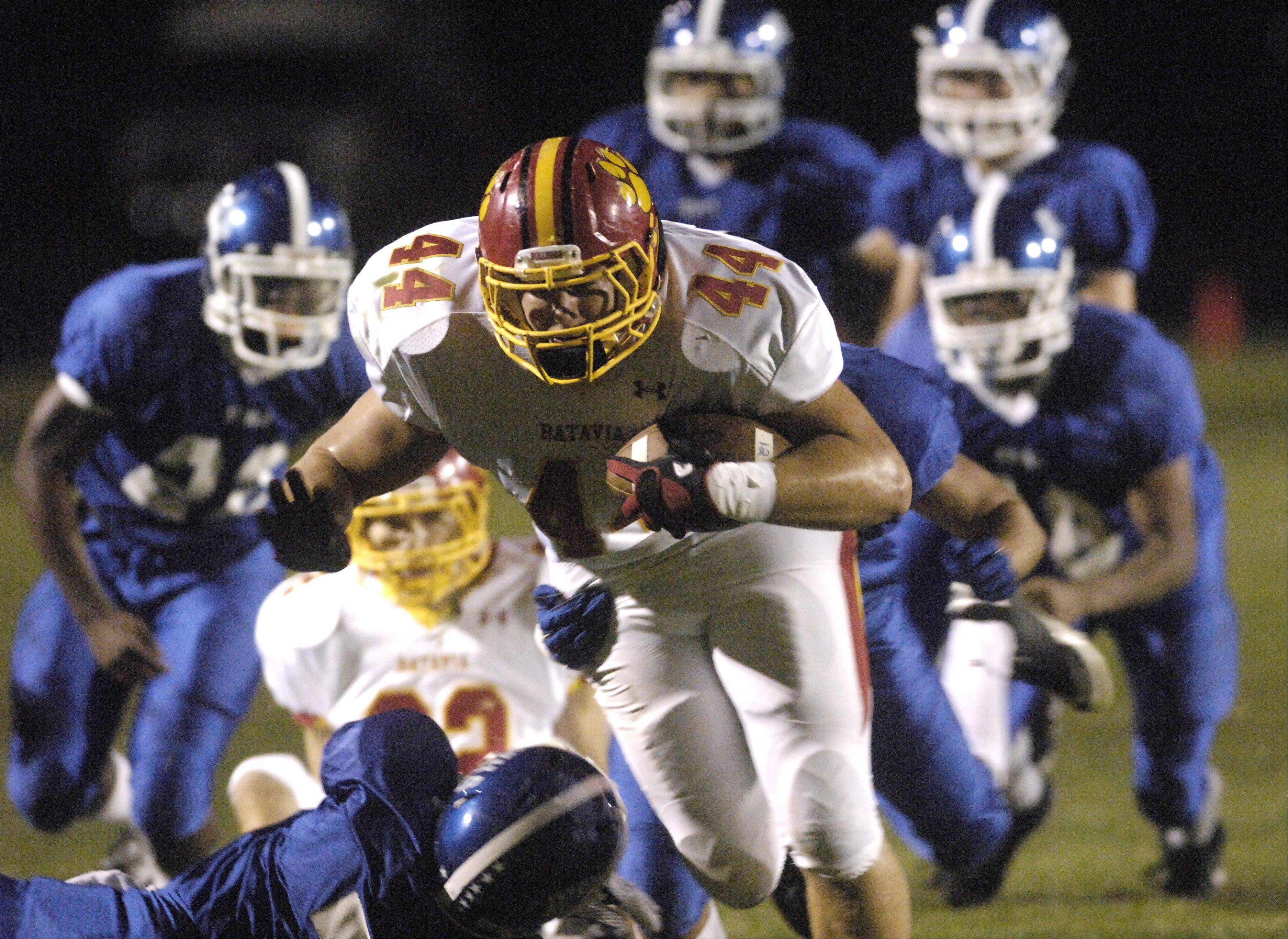Batavia?s Alec Lyons breaks through a pack of Larkin defenders for a gain during Friday?s action at Memorial Field in Elgin.