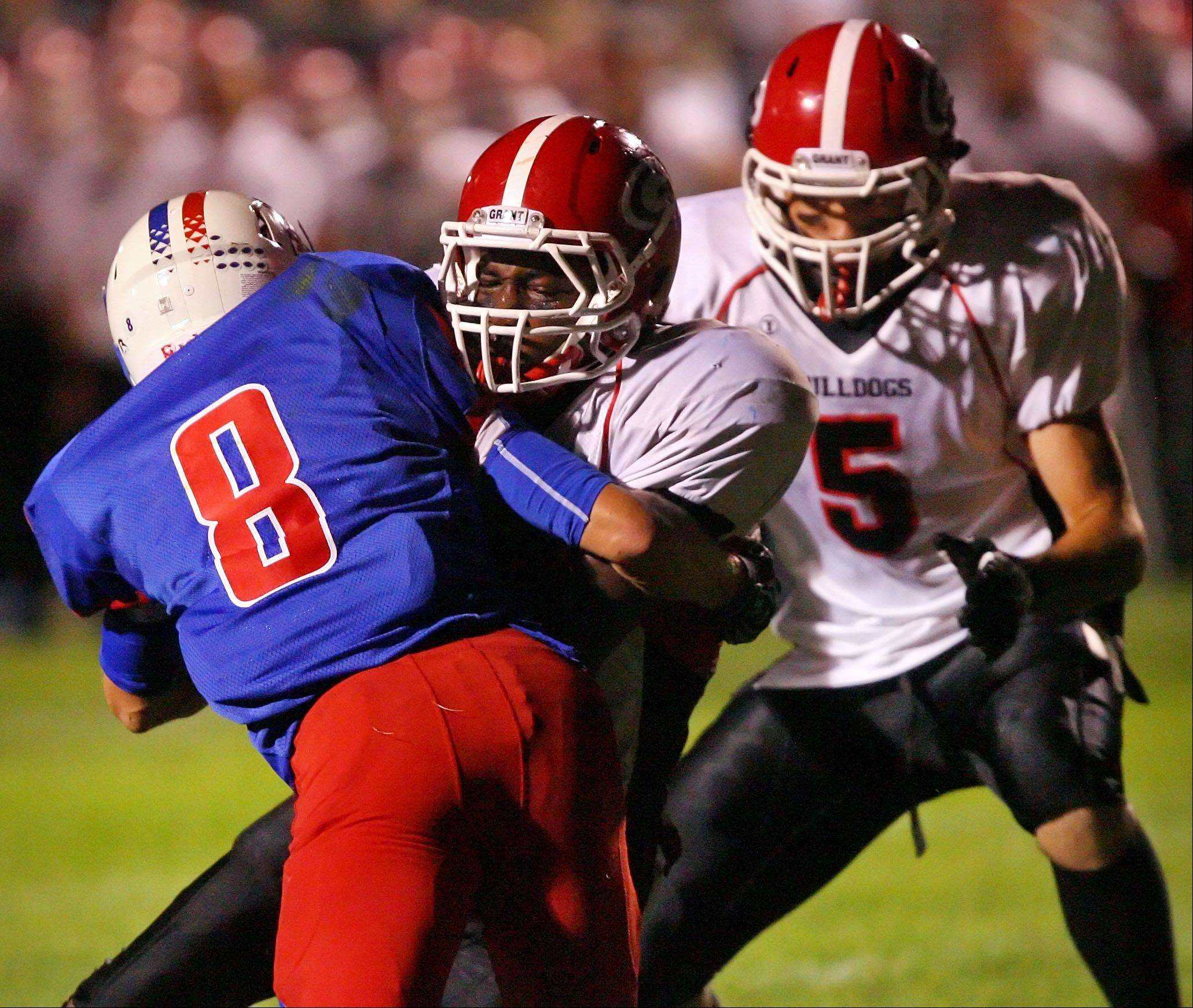 Week 3- Lakes� Drew Recker, left, and Grant�s Jonathan Wells collide as Grant�s Jerry Gaylor looks on.