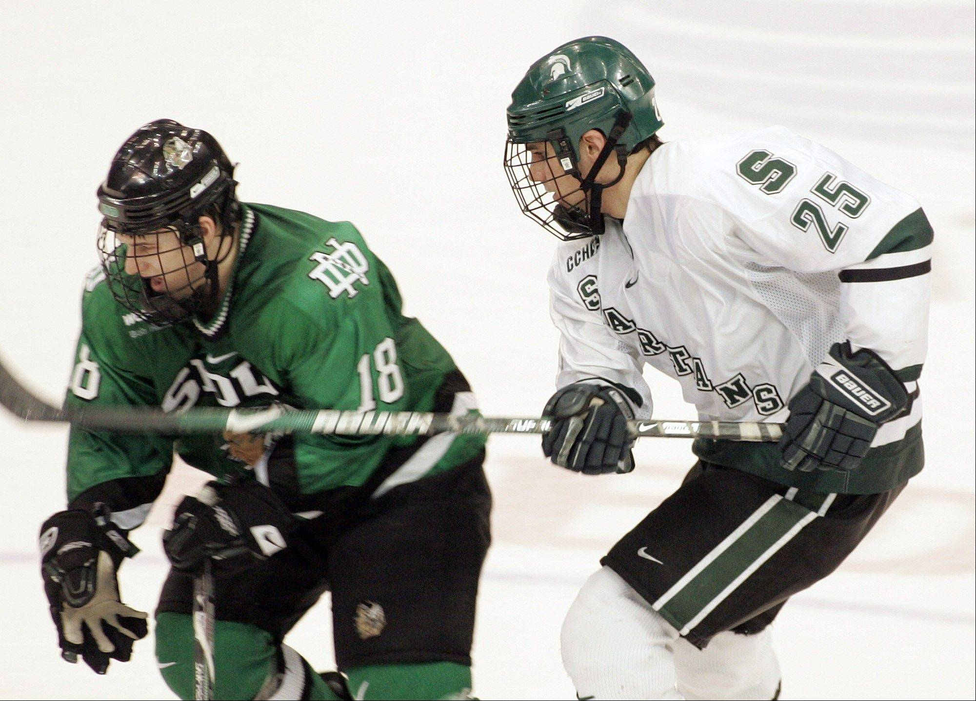 David Toews, left, battled Michigan State�s Corey Tropp in this Great Lakes Invitational college hockey game on Dec. 27, 2008 in Detroit. The Blackhawks acquired Toews, the younger brother of Jonathan, from the New York Islanders on Friday.
