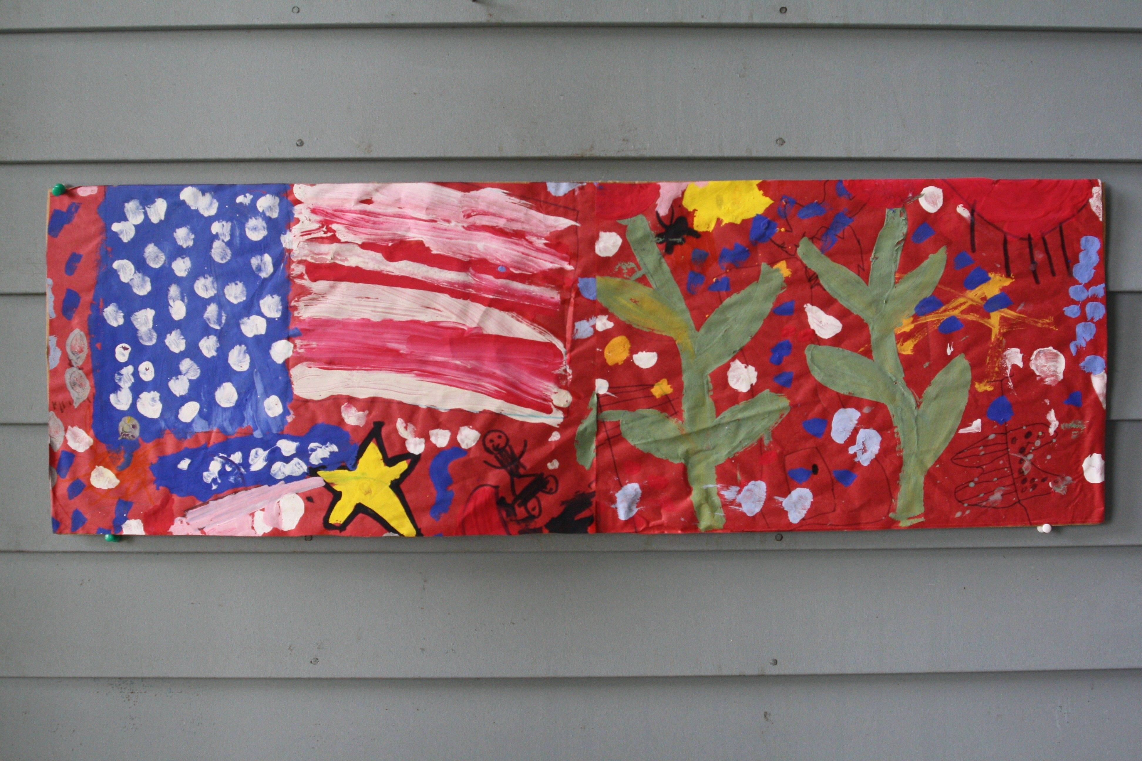 A portion of a mural commemorating the events of Sept. 11, 2001, painted by students from Louise White Elementary School in Batavia, hangs on a wall in the home of Daily Herald columnist Sammi King.
