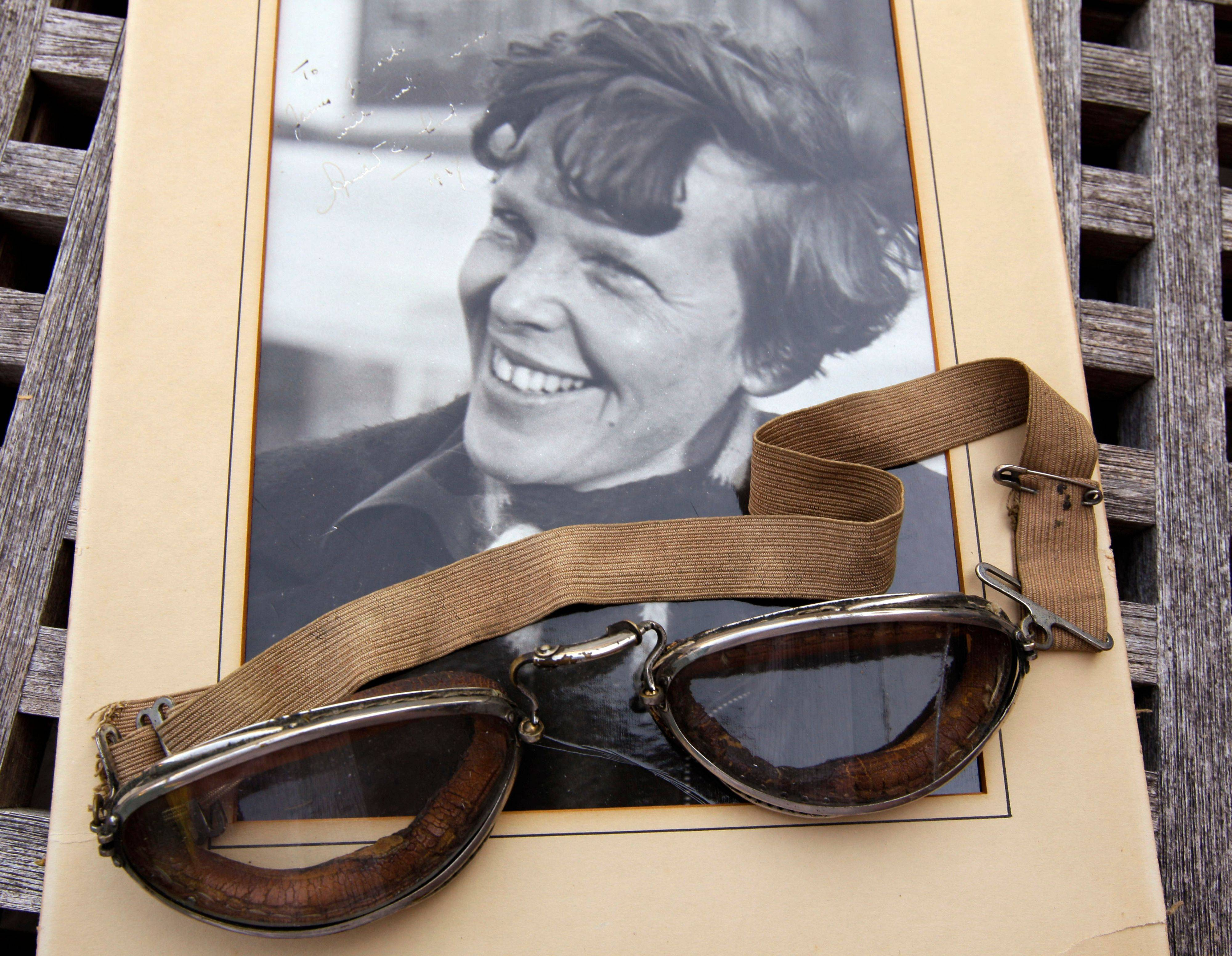 An original, unpublished personal photo of Amelia Earhart dated 1937, along with goggles she was wearing during her first plane crash, are going on the auction block at Clars Auction Gallery in Oakland, Calif.