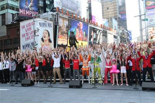 "Broadway performers sing ""New York, New York"" to commemorate the 10th anniversary of the Sept. 11 attacks, on Sept. 9, in New York's Duffy Square. The mini-concert was a replay of what the Broadway community sang 10 years ago to promote theater in New York City following 9/11."
